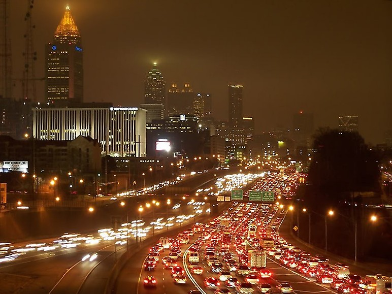 View of downtown connector with cars sitting in traffic.