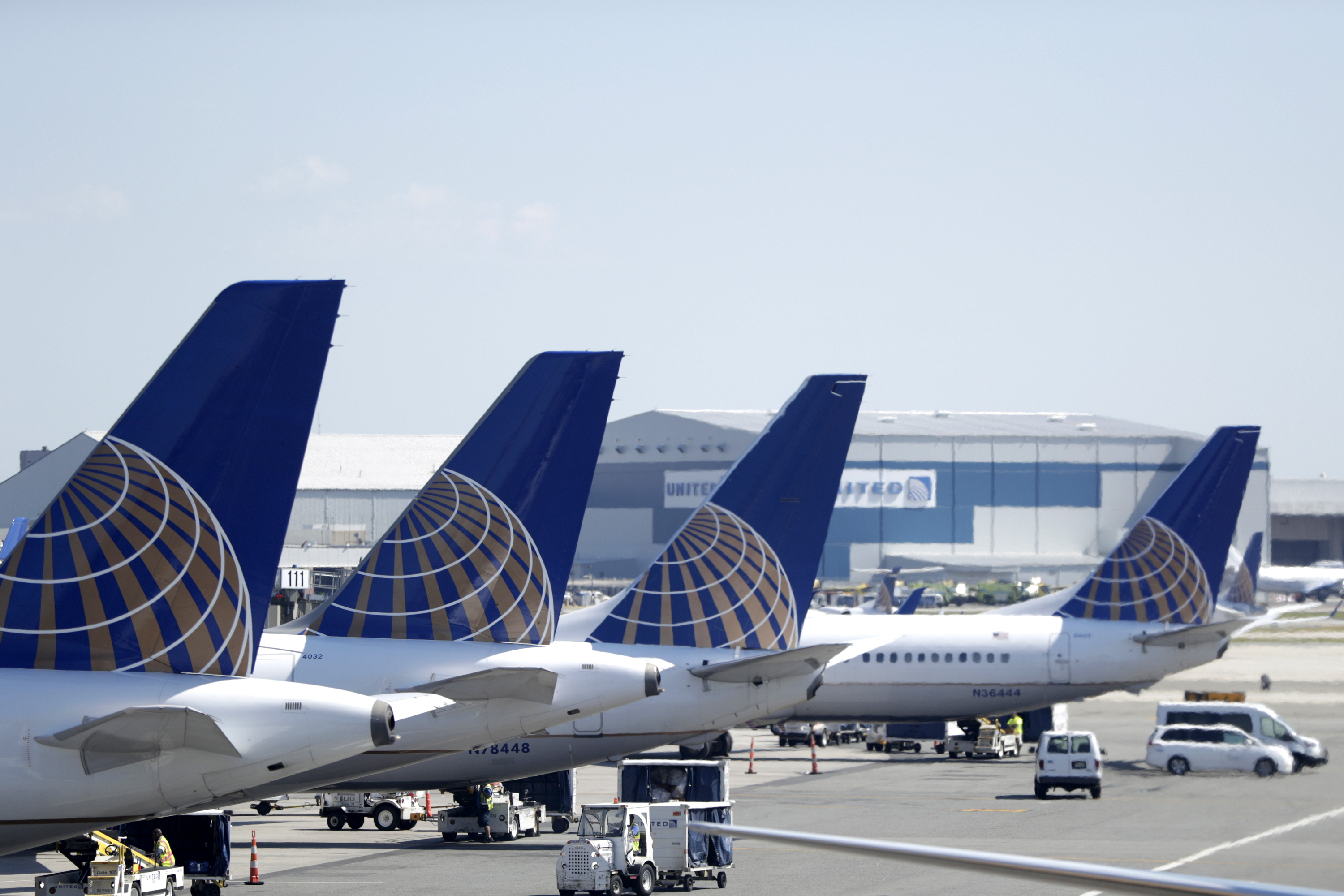 In this July 18, 2018, file photo, United Airlines commercial jets sit at a gate at Terminal C of Newark Liberty International Airport in Newark, N.J.