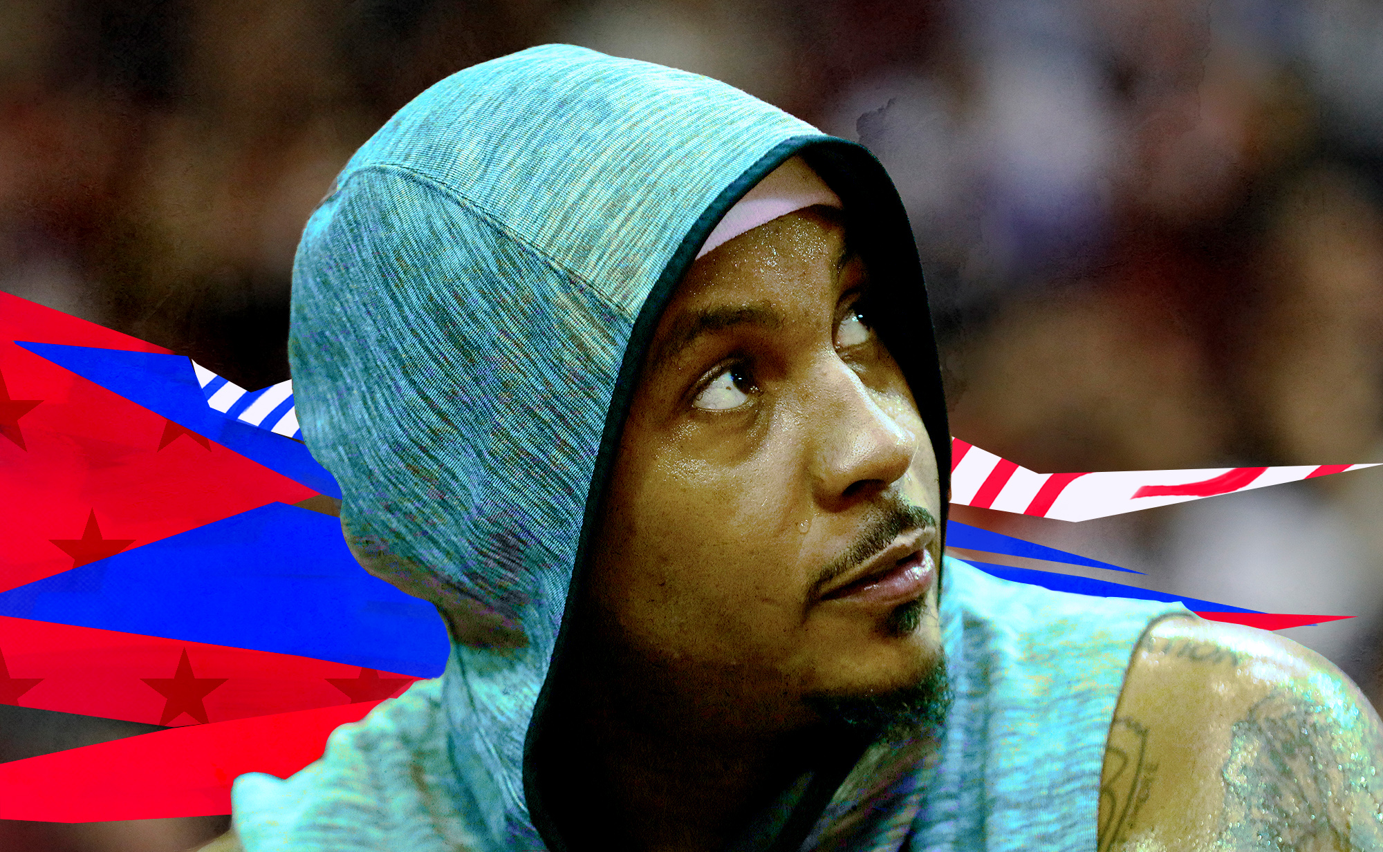Carmelo Anthony sits on the bench during an NBA game.