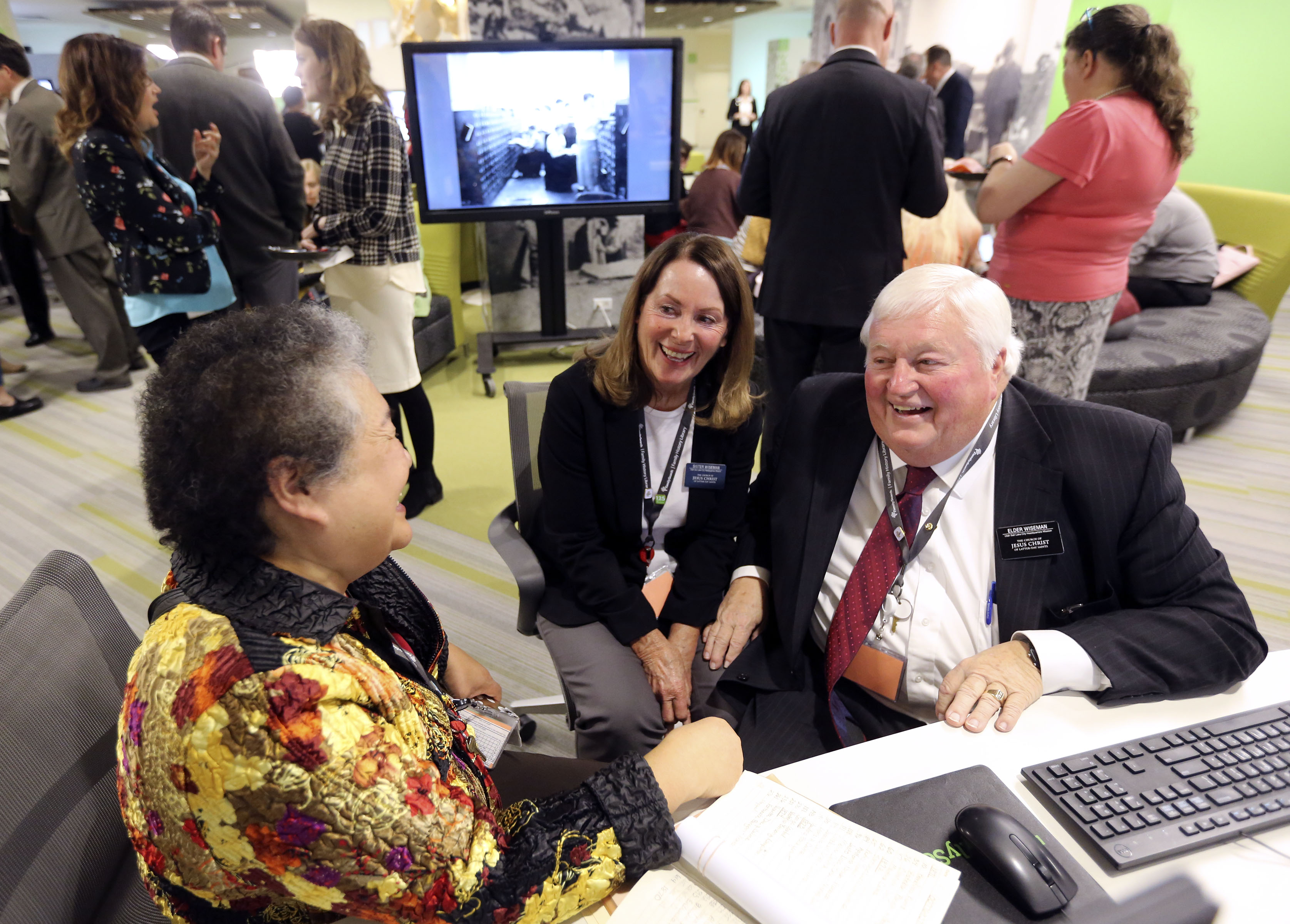 Sister Rosemary Pangan, Sister Diana Wiseman and Elder Steve Wiseman chat during the FamilySearch 125th anniversary celebration at the Family History Library in Salt Lake City on Wednesday, Nov. 13, 2019.