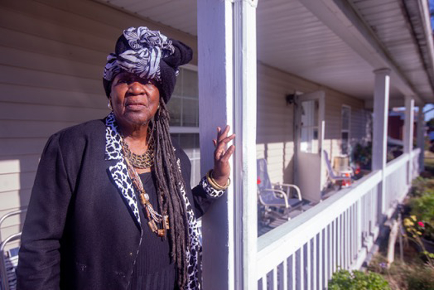 Mamie Cosey, 78, on the front porch of her home near the Veolia waste incinerator she blames for making her three great-grandchildren sick.
