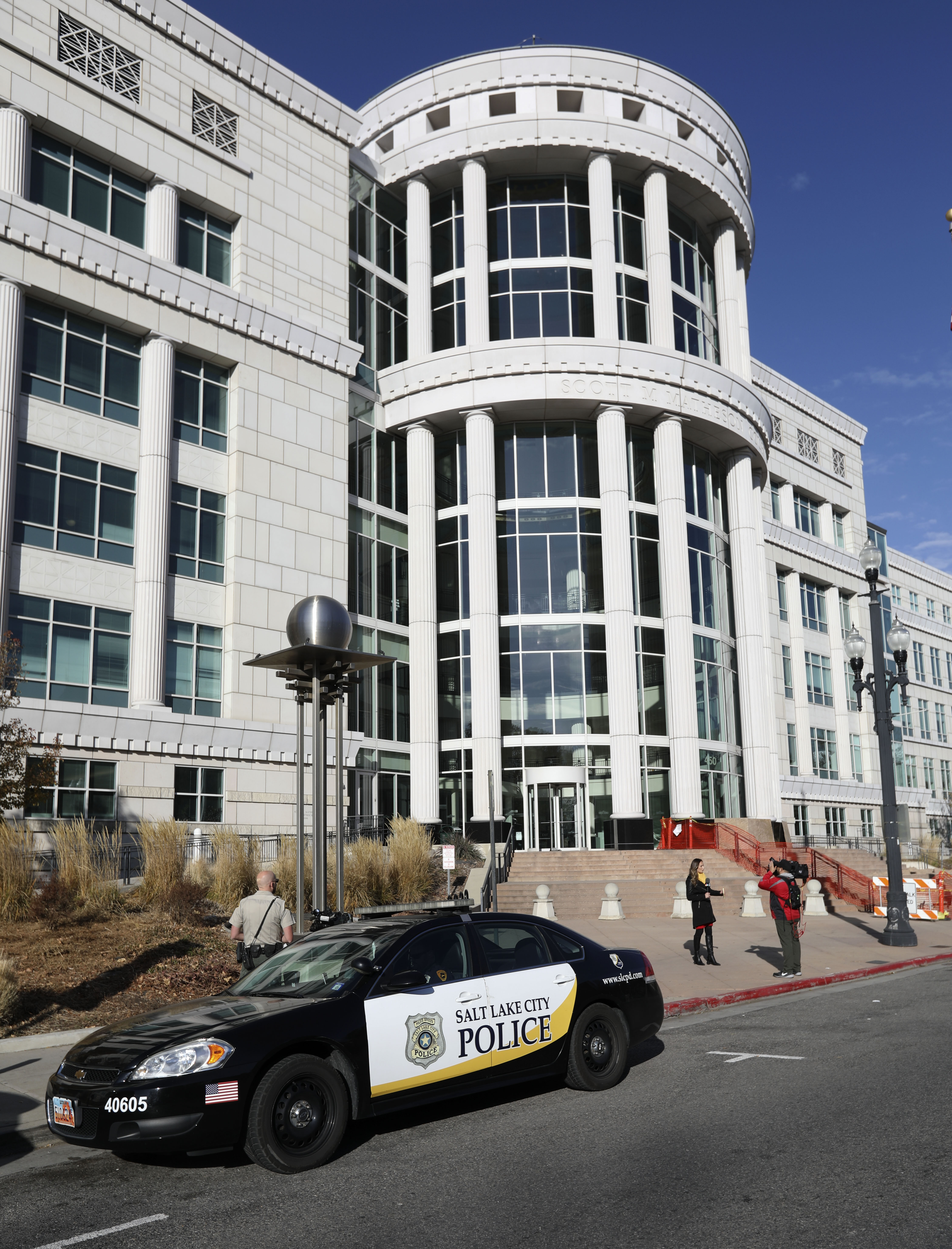 A Salt Lake City police vehicle is seen at the Matheson Courthouse in Salt Lake City after a wounded man entered the building on Friday, Nov. 15, 2019.