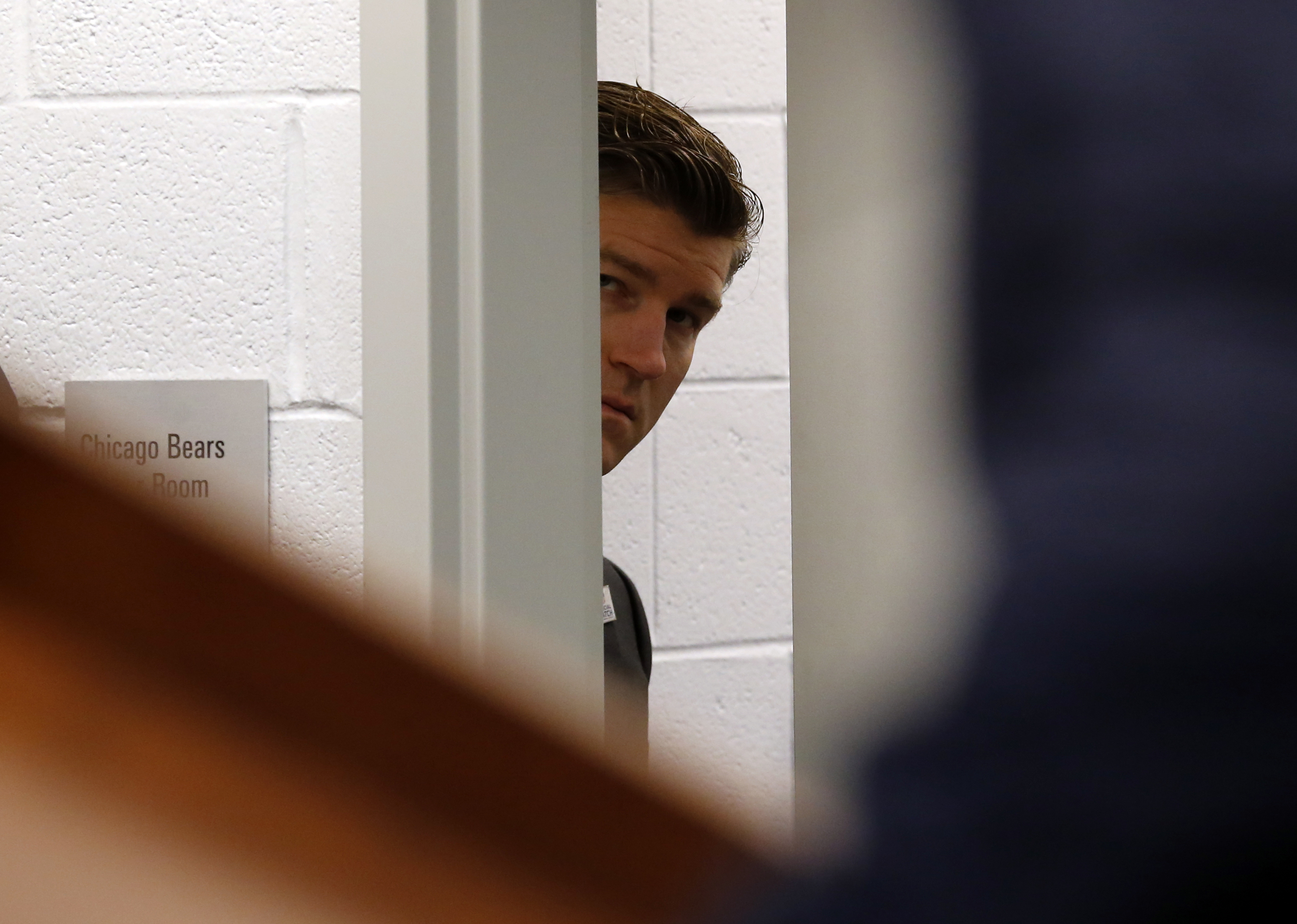 Bears general manager Ryan Pace listens through a doorway during a 2017 press conference at Soldier Field.