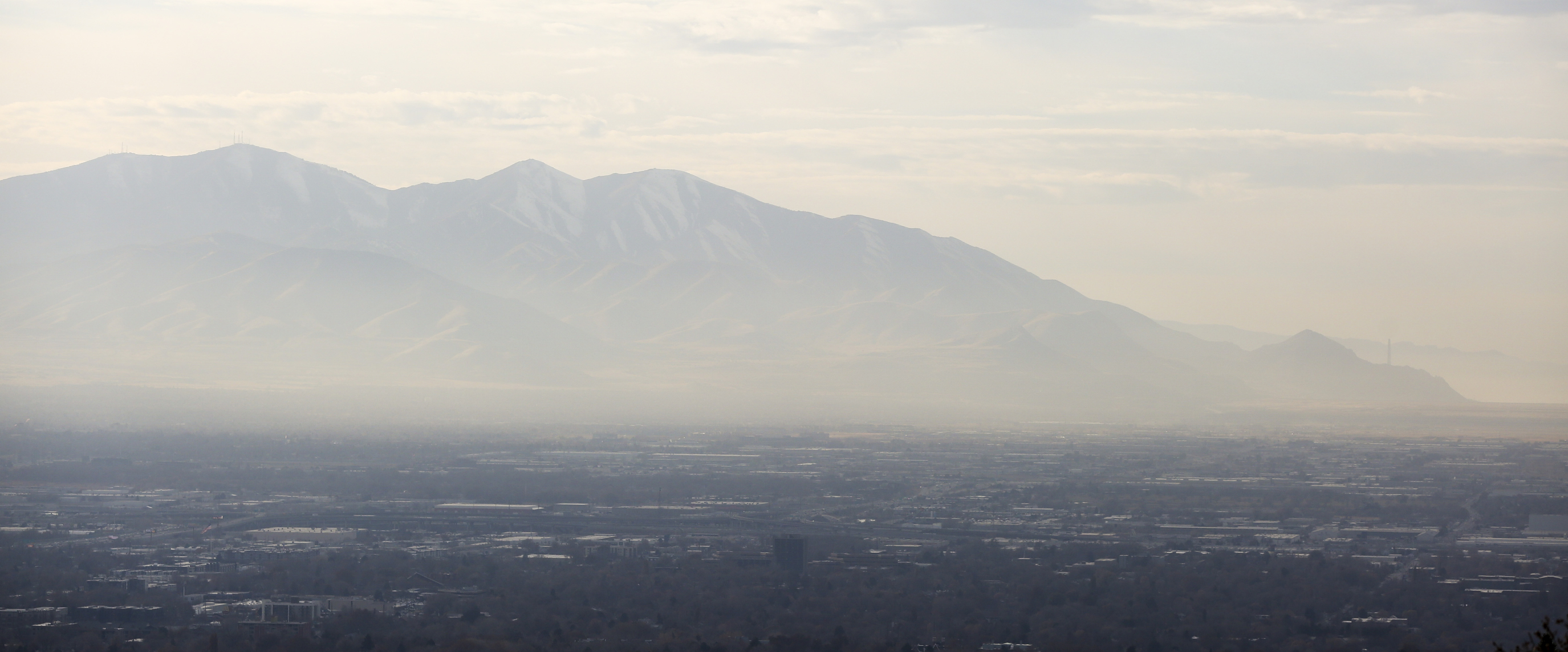 A layer of haze hangs over the Salt Lake Valley on Friday, Nov. 15, 2019.