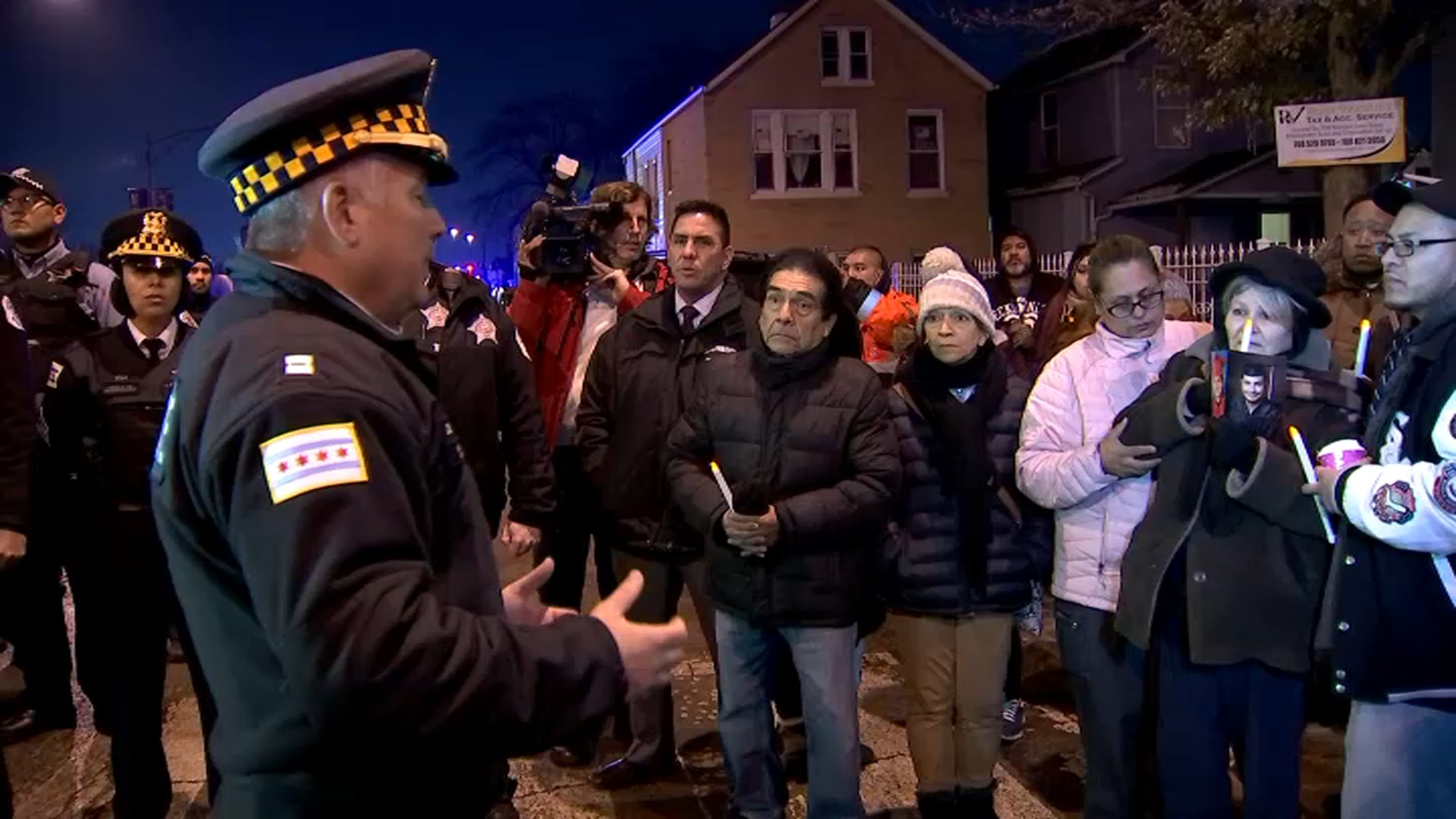 Police and community members gathered in Little Village