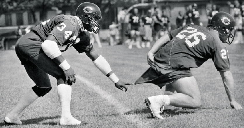 Bears legend Walter Payton pulls down teammate Matt Suhey's shorts at minicamp in 1985.