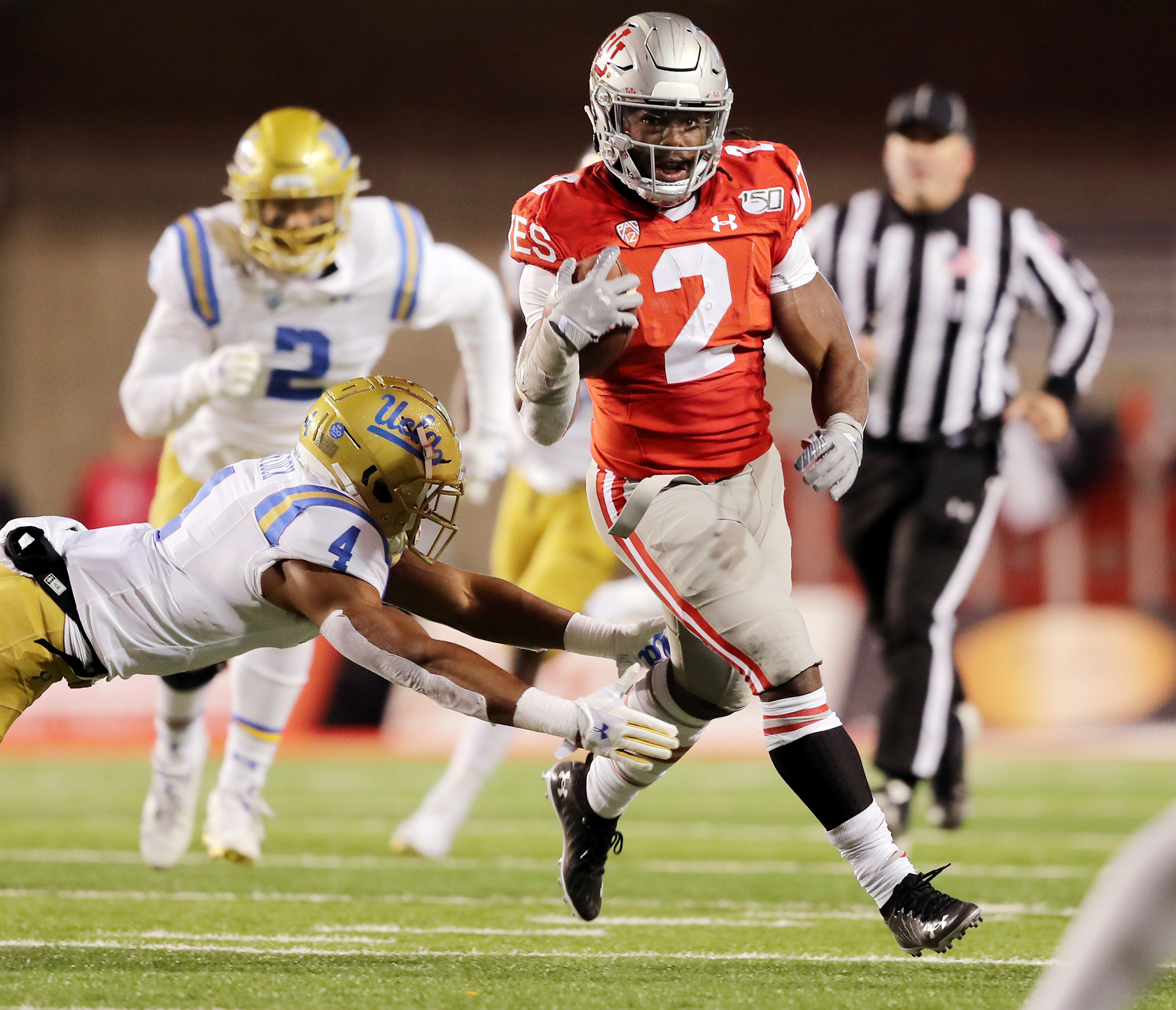 Utah Utes running back Zack Moss (2) breaks away from UCLA Bruins defensive back Stephan Blaylock (4) as Utah and UCLA play a college football game in Salt Lake City at Rice Eccles Stadium on Saturday, Nov. 16, 2019.