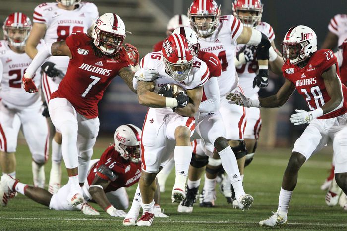 Louisiana running back Elijah Mitchell (15) forges ahead for a first down as South Alabama safety DJ Daniels (13) makes the tackle in the second half of a NCAA football game Saturday, Nov. 16, 2019, at Ladd-Peebles Stadium in Mobile, Ala.