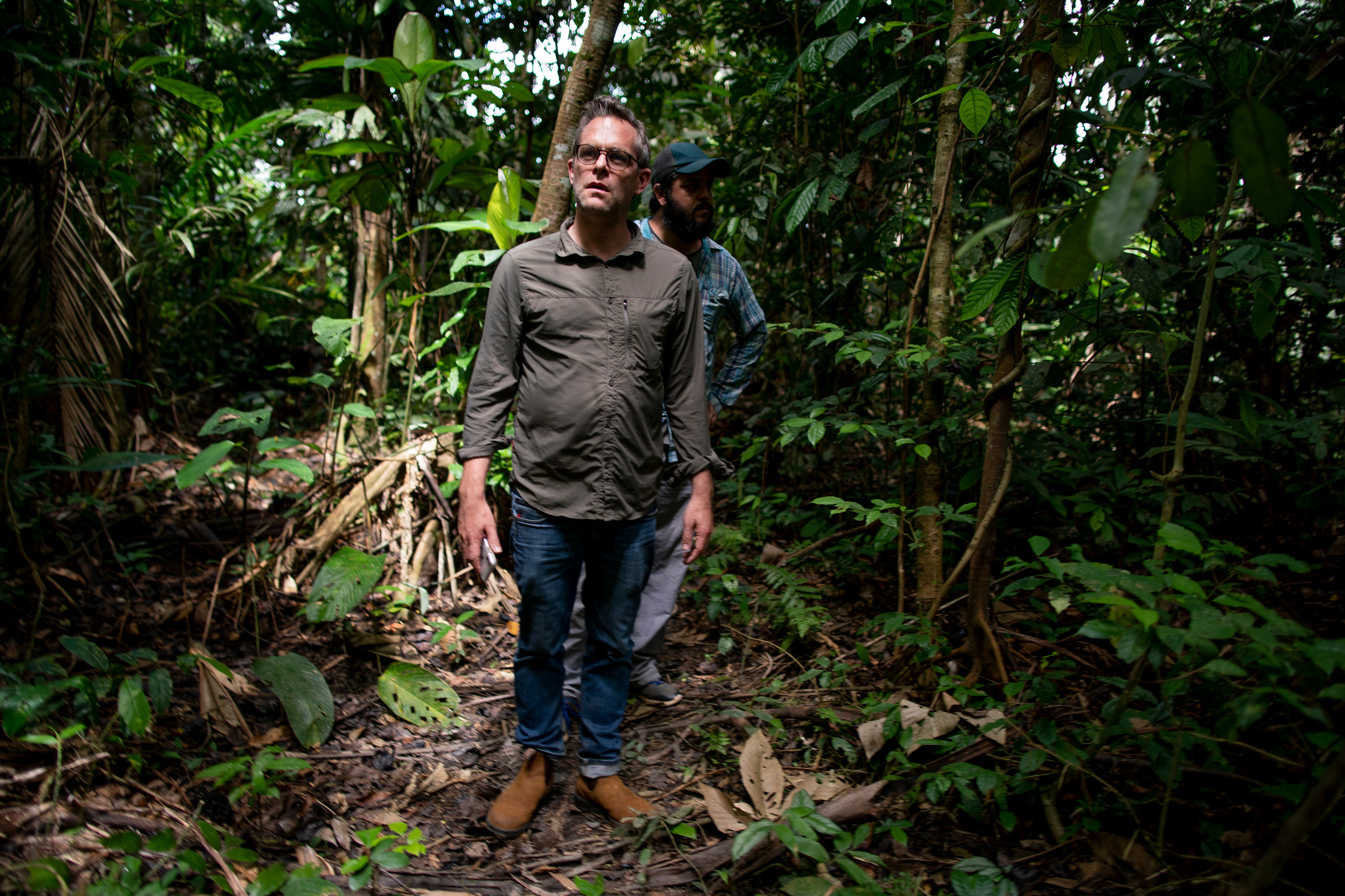 Deseret News reporter Jesse Hyde, along with translator Gabriel McCrate, walks through the forest while accompanying Elias da Silva Lima, 63, between his home and a clearing he farms on the Virola Jatoba settlement in Anapu, Brazil, on Thursday, June 13, 2019.