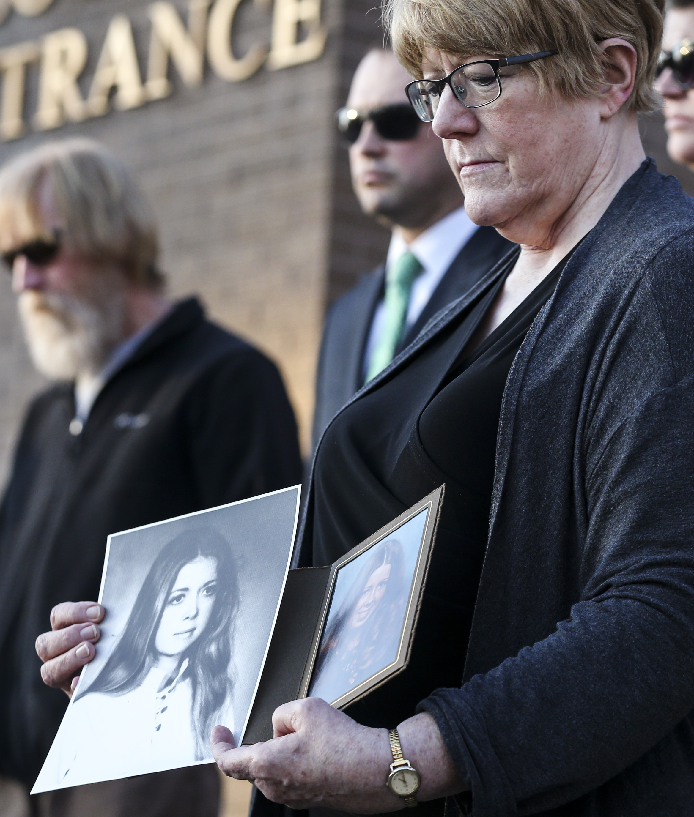 Leah Scharp displays pictures of her sister, Marla Scharp, during a press conference at the Provo Police Department in Provo on Saturday, Nov. 16, 2019, where the Utah Cold Case Coalition announced Marla Scharp's murder case is being reopened. Marla Scharp's body was discovered in her home in June 1978. The case was closed in 1984 when Henry Lee Lucas confessed to the murder, but Lucas' confession has since been debunked.