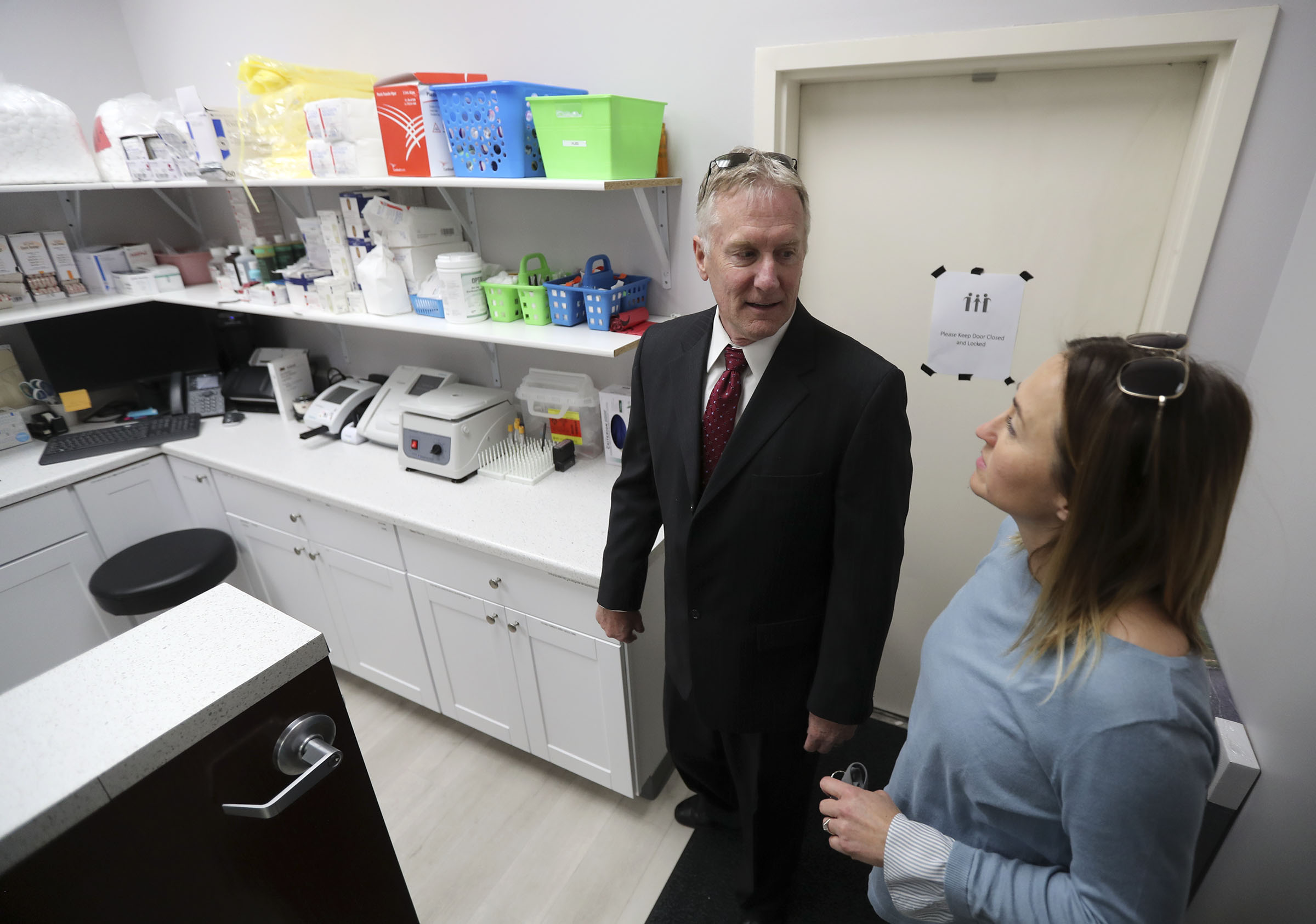 Kurt Micka, executive director of Utah Partners for Health, gives Jennifer Pewder, a registered nurse with the Salt Lake County Health Department, a tour of the new Utah Partners for Health Family Clinic in West Jordan on Friday, Nov. 8, 2019.