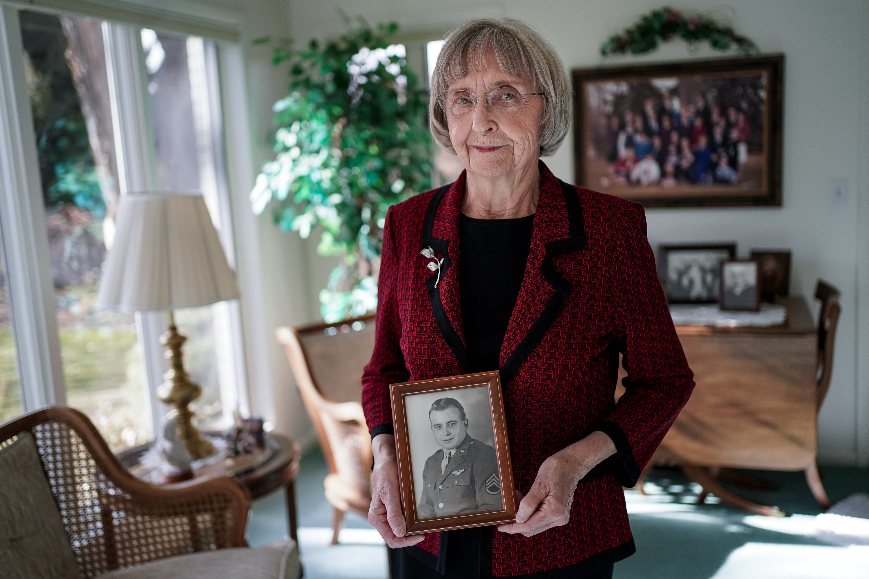 Helen Lower Simmons poses for a portrait while holding a photograph of her brother, Max Wendell Lower, taken while he served in the Army Air Forces during World War II, at her home in Logan on Thursday, Nov. 14, 2019. Max Lower was killed when his plane was shot down during the Operation Tidal Wave attacks on Romanian oil refineries during the war. His remains were recently identified using DNA technology and will soon be returned to his family in Utah.