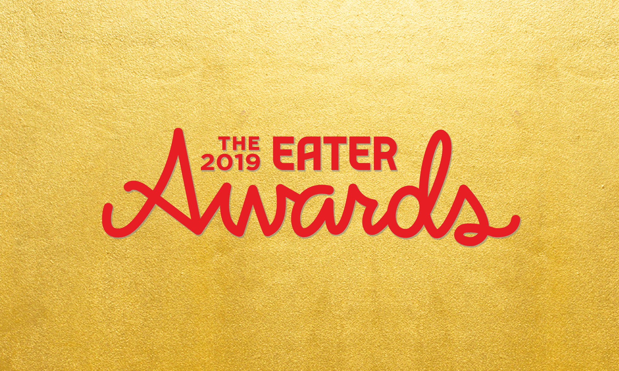 A gold background with red writing reading The 2019 Eater Awards.