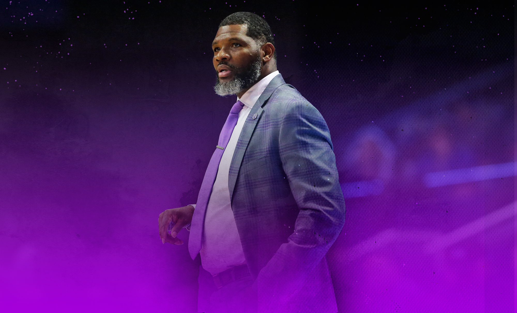 Evansville basketball coach Walter McCarty looks upon the court.
