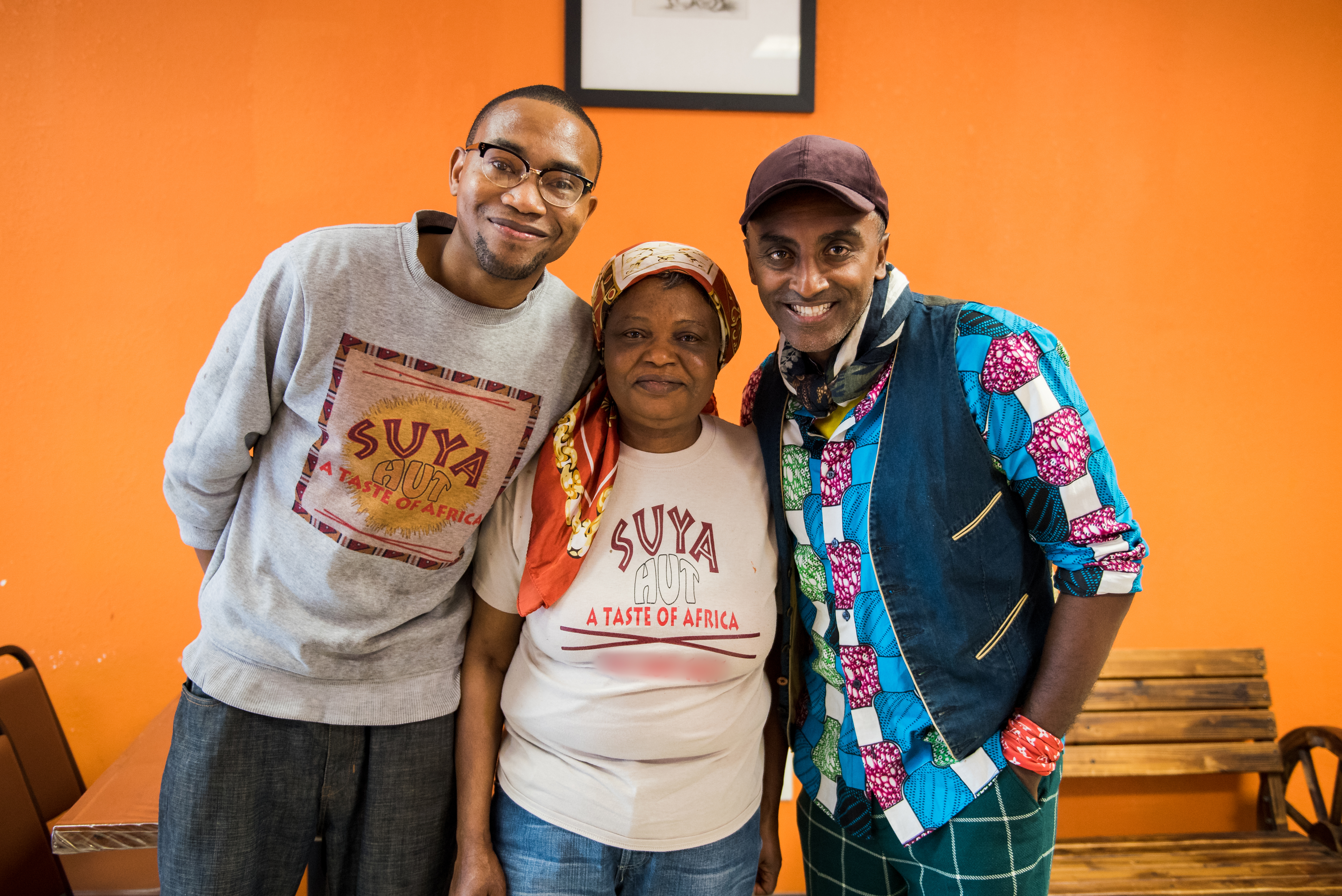 Marcus Samuelsson with Suya Hut chef and owner Patricia Nyan and cook Ahmadu A.