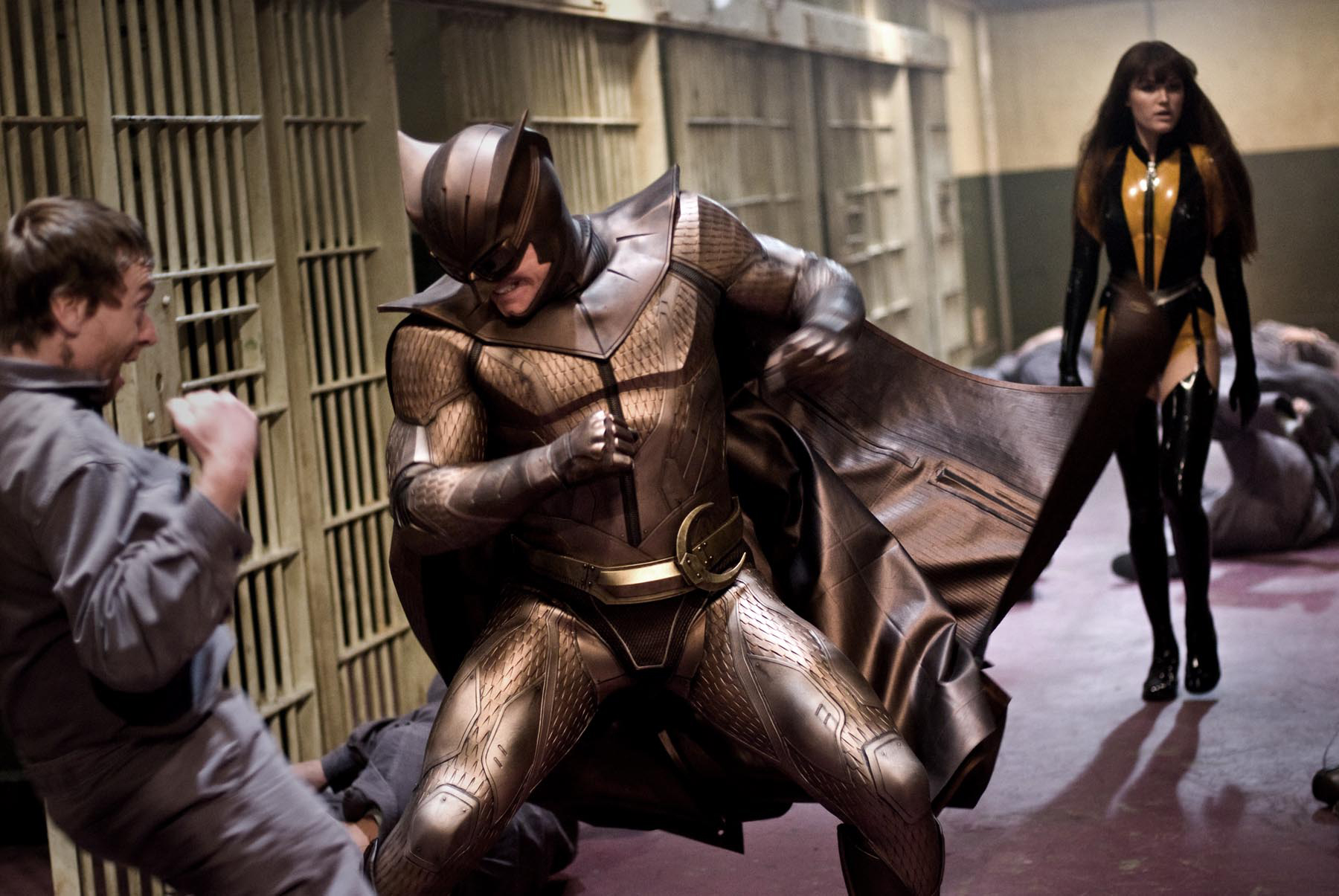 watchmen 2009 nite owl fights a prison guard as laurie walks up behind him