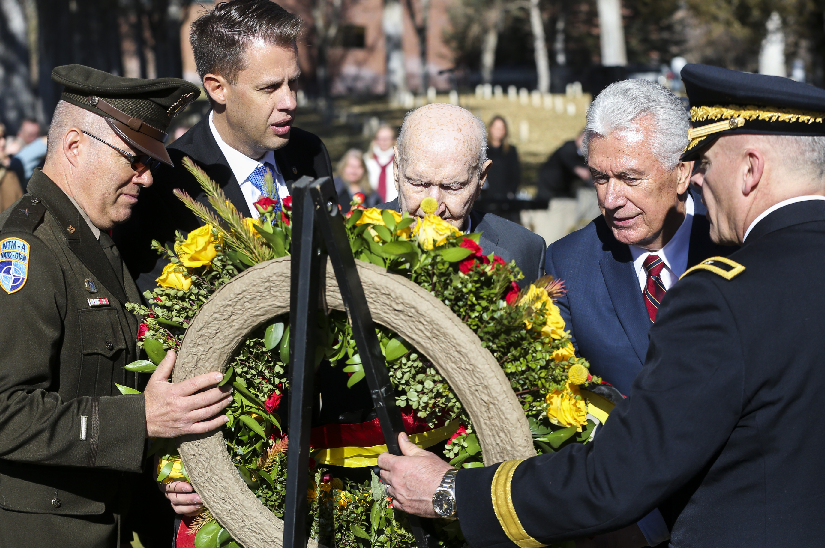 From left, Brig. Gen. Douglas Cherry, James Burton, honorary consul to the Republic of Germany, Berlin airlift member Gail Halvorsen, Elder Dieter F. Uchtdorf, of the Quorum of the Twelve Apostles of The Church of Jesus Christ of Latter-day Saints, and Brigadier Gen. Michael Turley place a wreath during the Volkstrauertag ceremony at the Fort Douglas Military Cemetery in Salt Lake City on Sunday, Nov. 17, 2019. Volkstrauertag is the German National Day of Remembrance where the German people honor those that have fall in the line of duty as well as those that were victims of the government. Fort Douglas Military Cemetery is the final resting place of several German prisoners of war that never made it back to Germany.