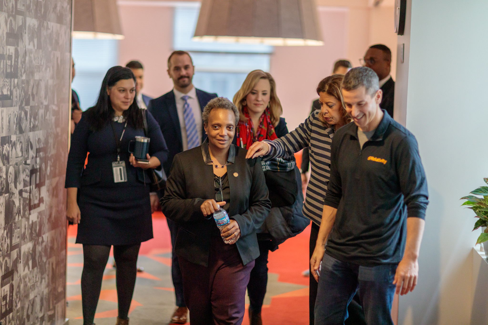 Mayor Lori Lightfoot talks with Mike Gamson, president of the downtown tech company Relativity, at the company's headquarters Monday.