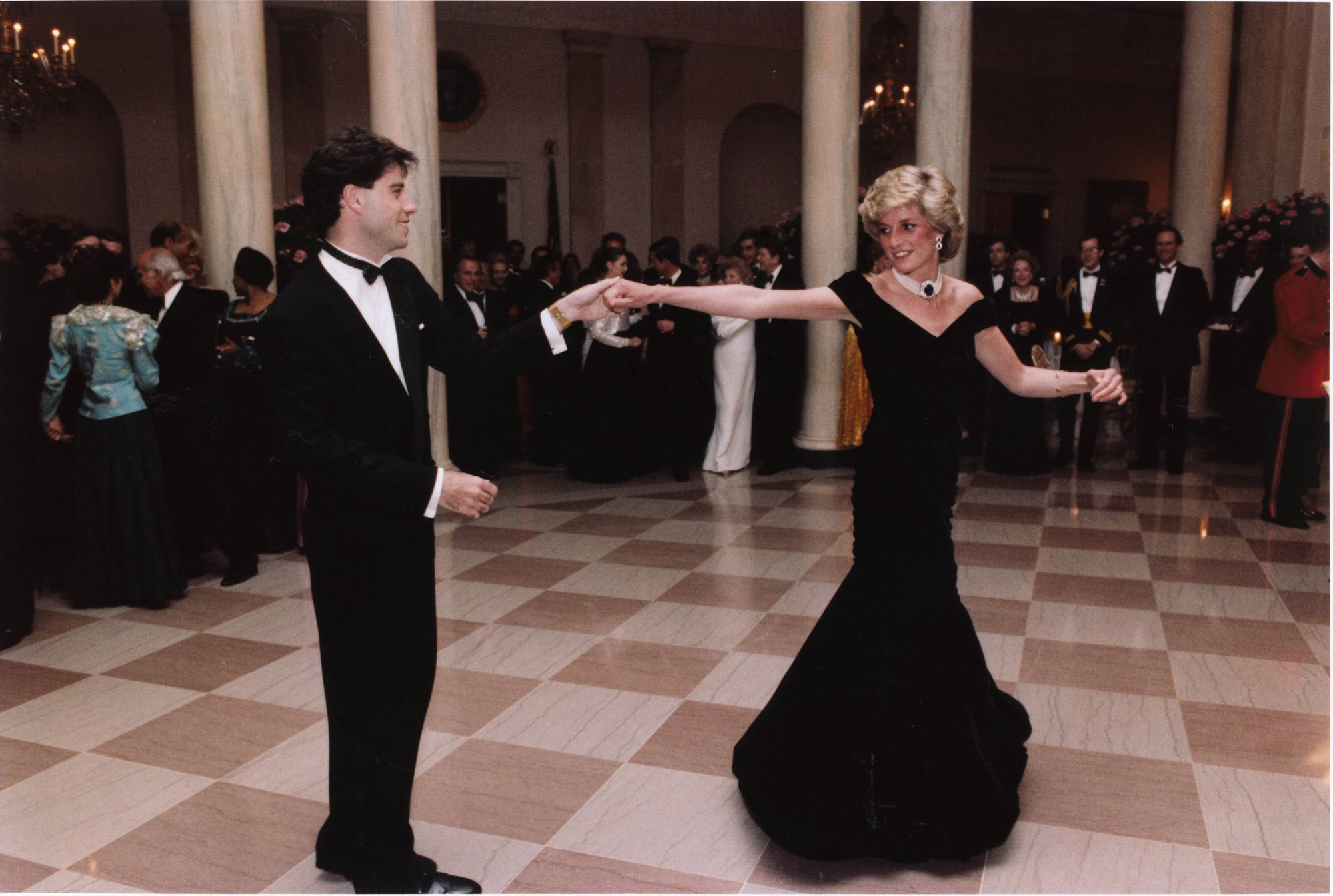 Actor John Travolta dances with Princess Diana at a White House dinner in 1995.
