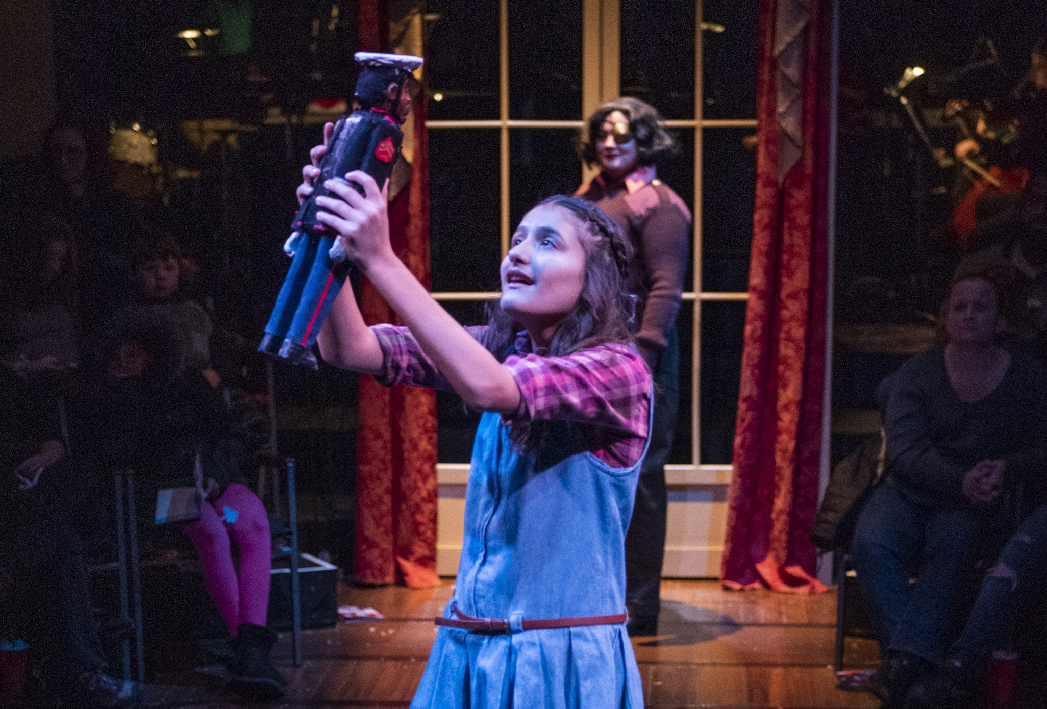 "Clara (Amaris Sanchez) marvels at the magical gift of a nutcracker made to look just like her brother, Fritz, in the House Theatre of Chicago's ballet-free production of ""The Nutcracker."""