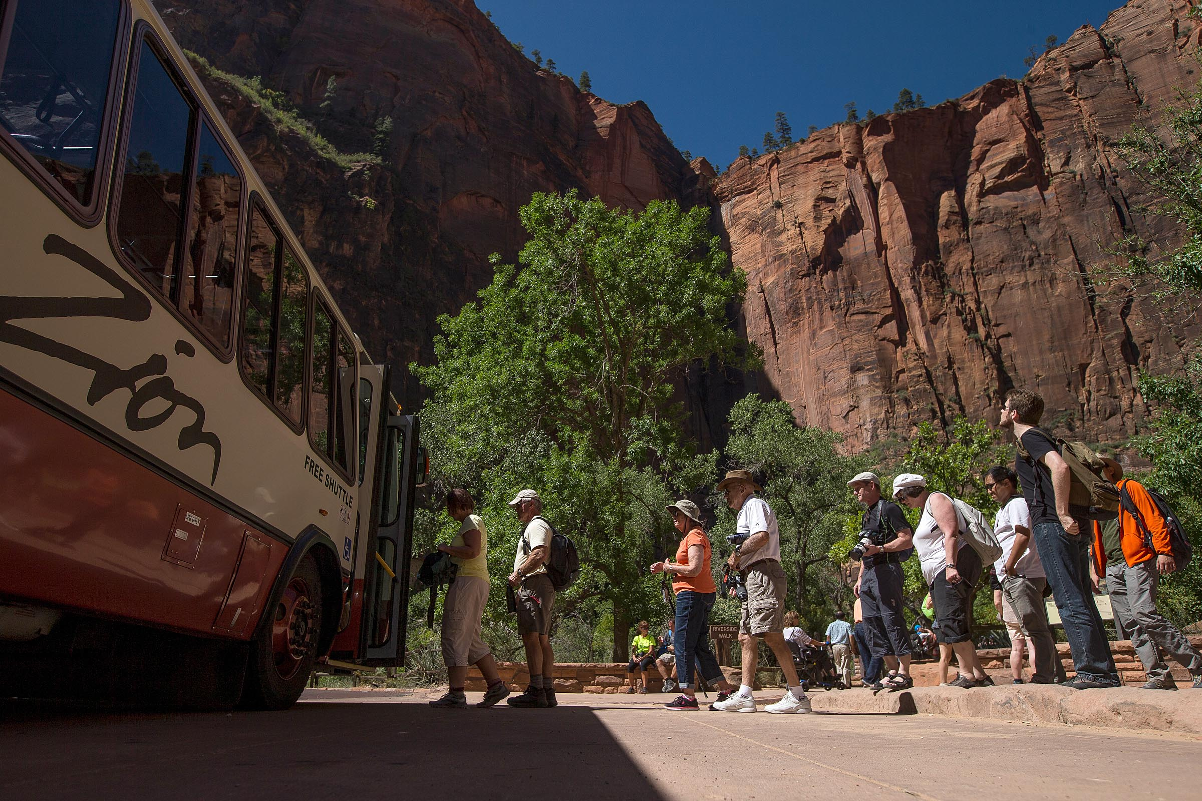 People board a shuttle in Zion National Park on Thursday, Sept. 15, 2016. The park's free shuttles ferry visitors between Springdale and the visitors center, as well as throughout the park, in an effort to alleviate traffic in Zion Canyon during the busy tourist season.