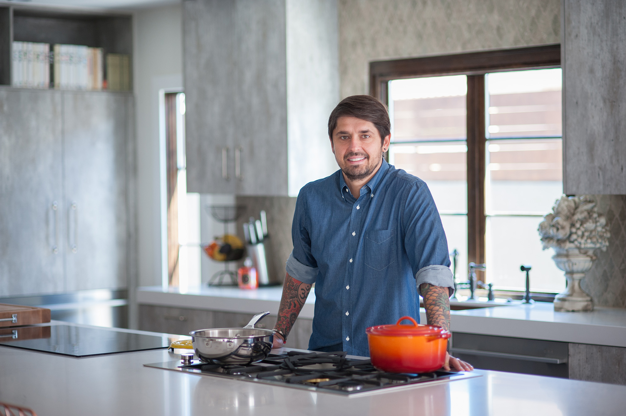 Ludo Lefebvre's home kitchen, looking clean as the chef stands behind his range.