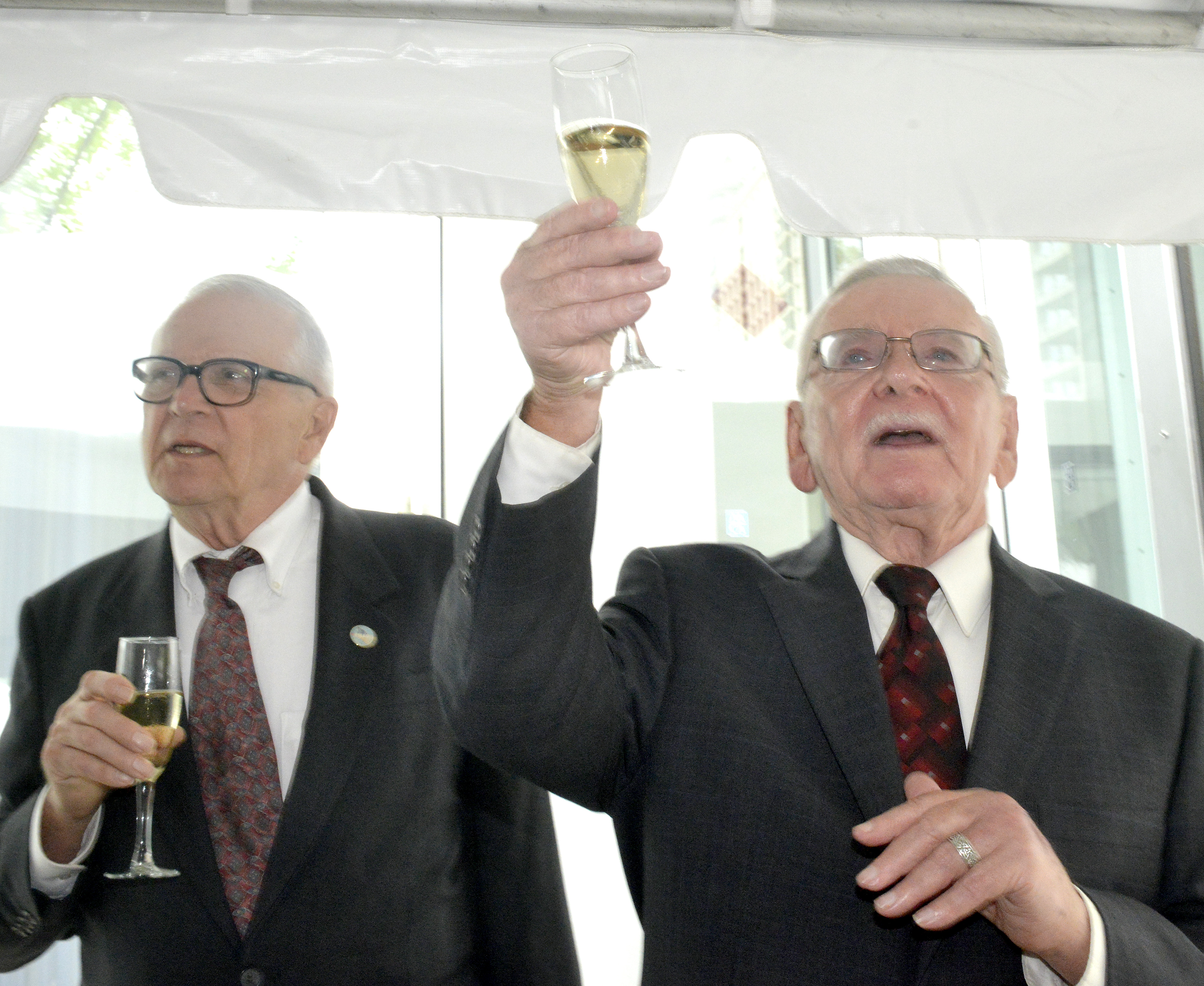 Patrick Bova, left, and James Darby celebrate with with a toast after their wedding in 2014