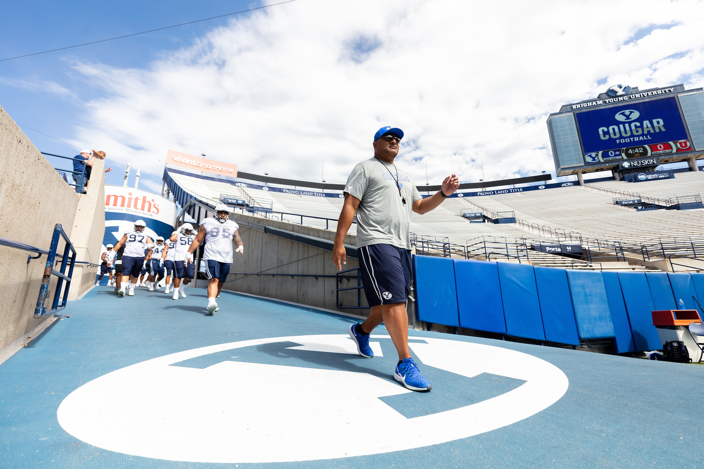BYU head coach Kalani Sitake walks down the ramp onto the field during the Cougars' scrimmage at LaVell Edwards Stadium on Saturday, Aug. 10, 2019.