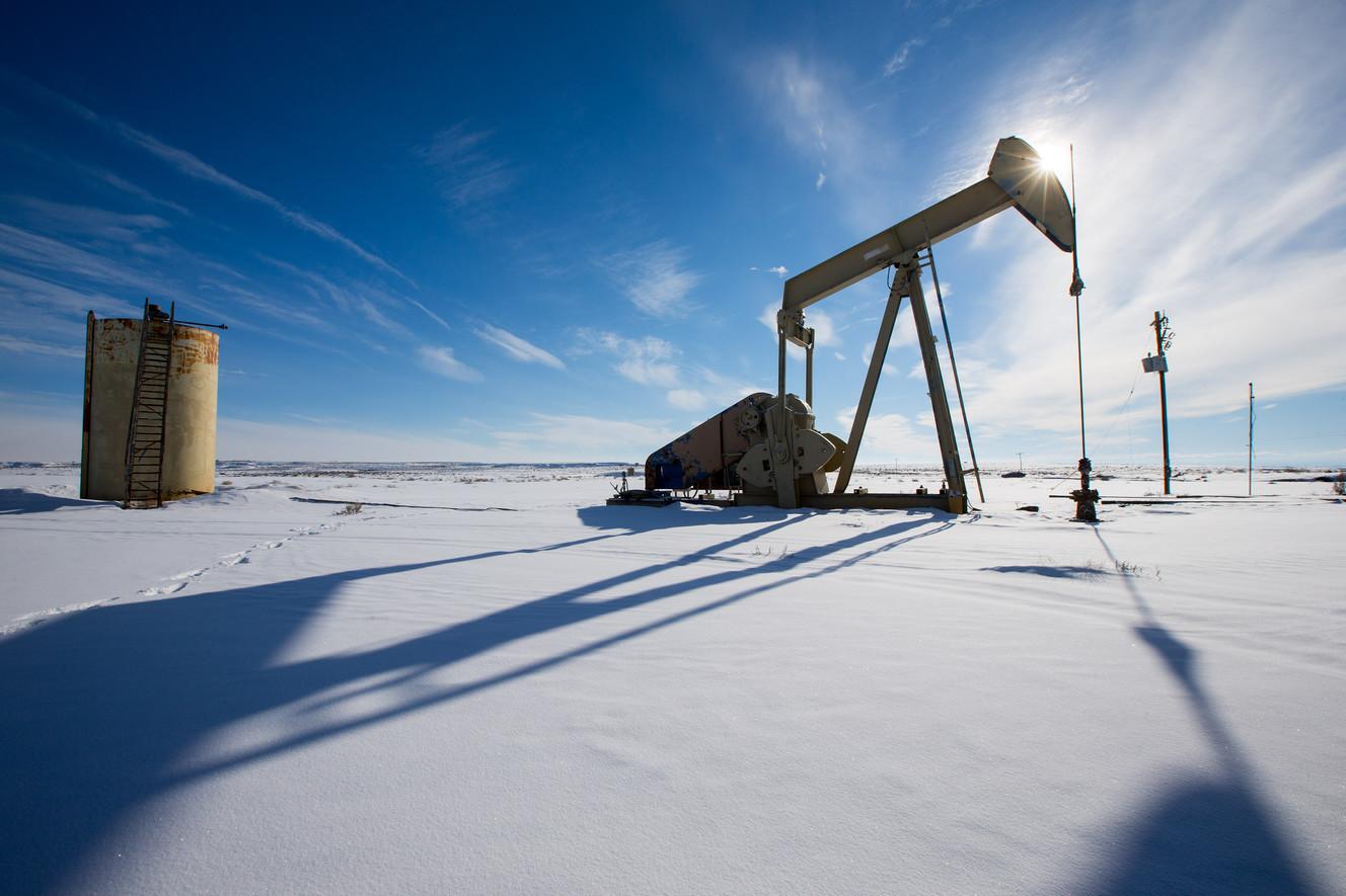 A oil pump sits idle near Ouray Utah on Thursday, Feb. 4, 2016.