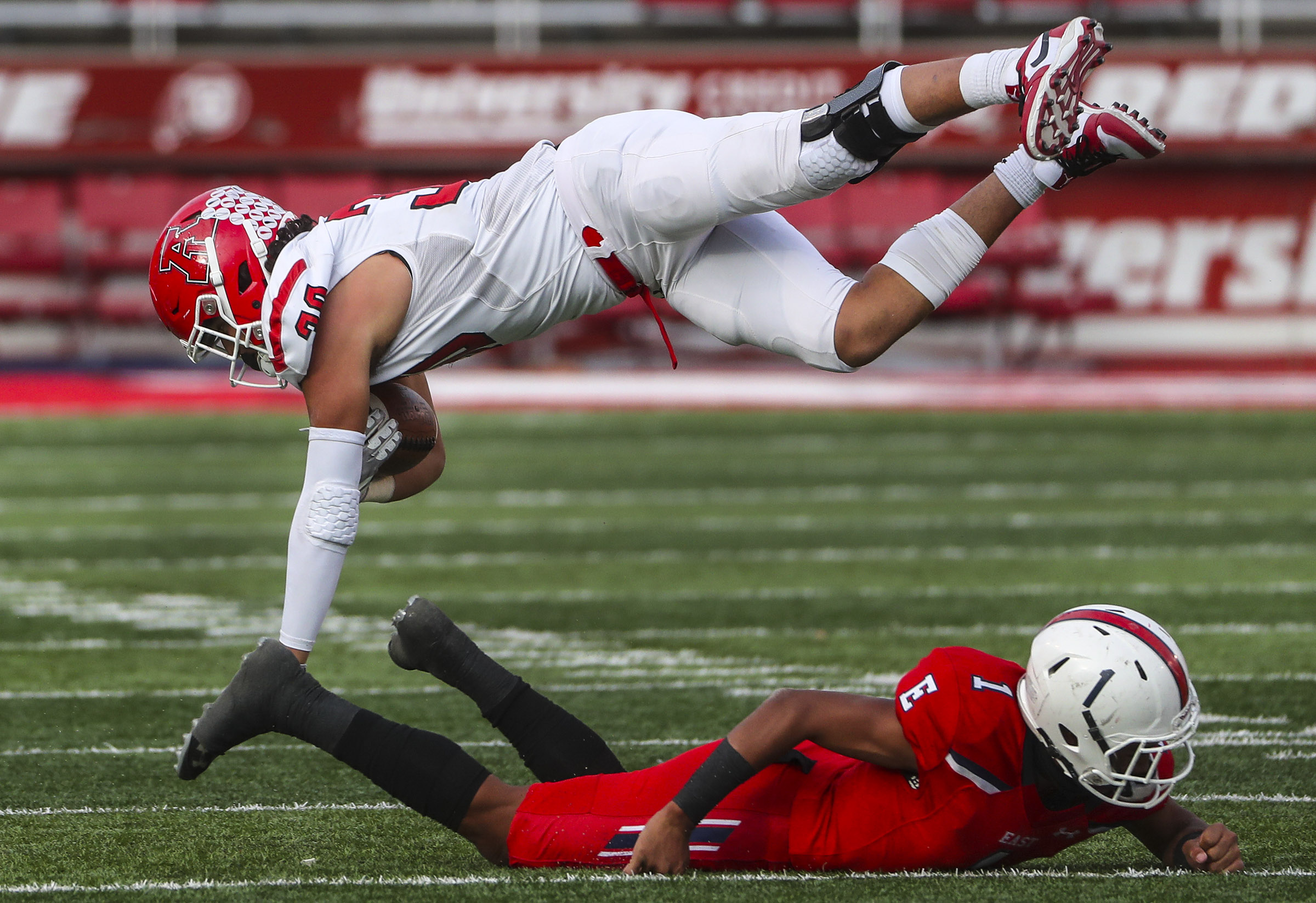 East safety Piuleini Tausinga knocks American Fork's Noah Moeaki into the air during 6A semifinal football game at Rice-Eccles Stadium in Salt Lake City on Friday, Nov. 15, 2019. The Cavemen defeated the Leopards, advancing to the championship game.