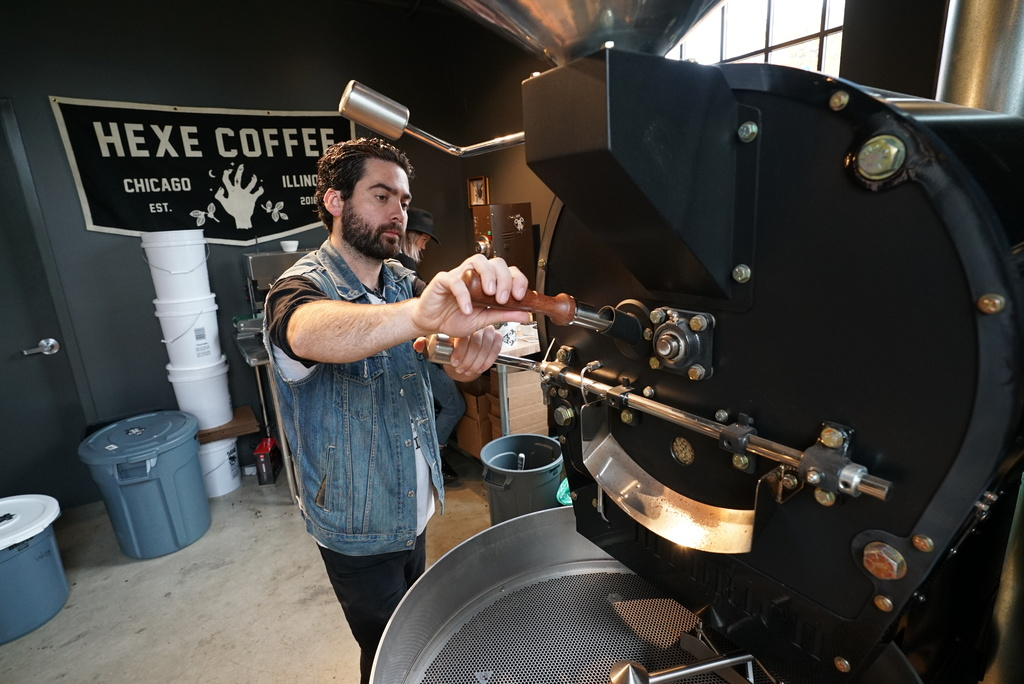 Parker Slade, the owner of Hexe Coffee, roasting coffee beans.