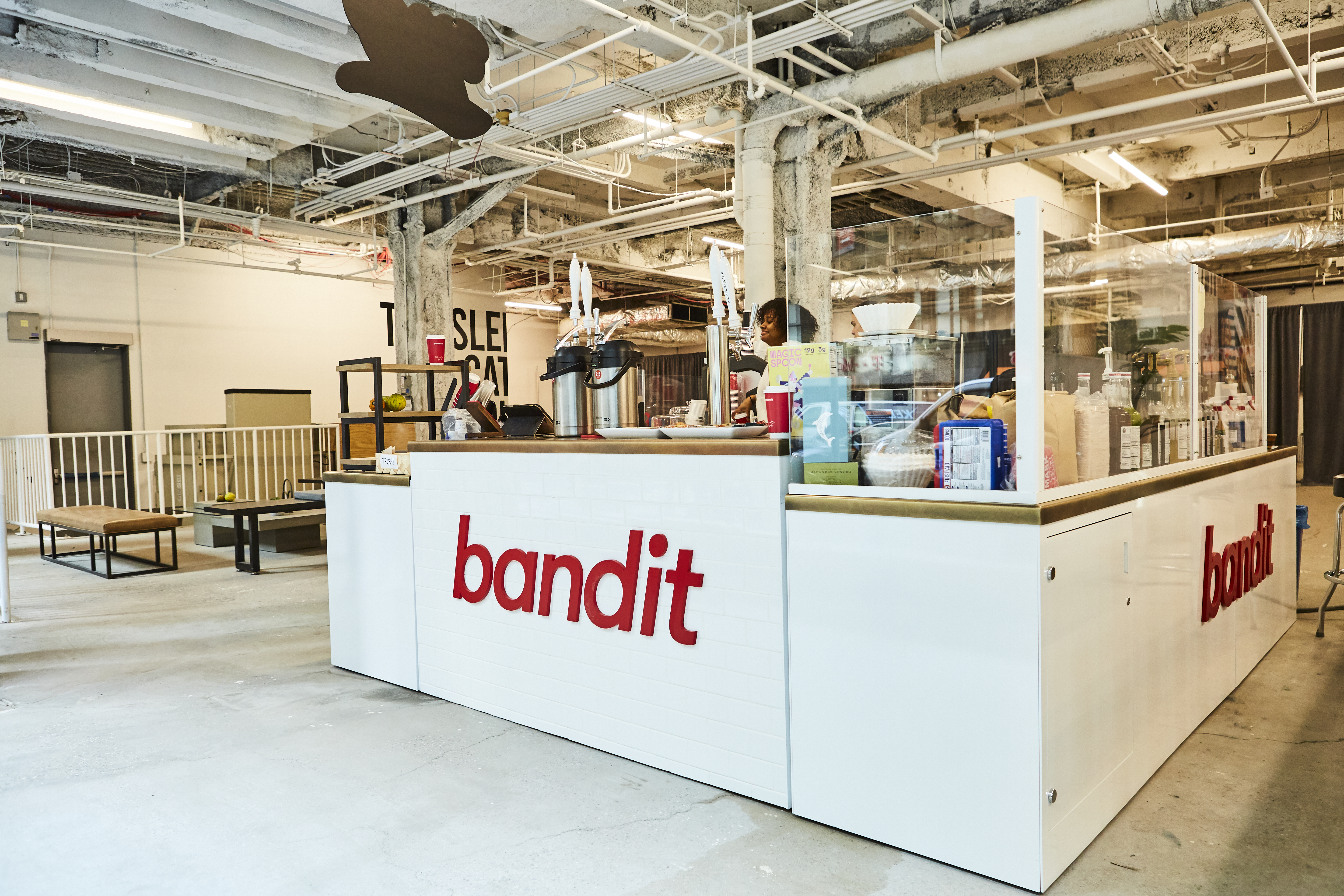 "A cafe counter with the red logo saying ""Bandit"""