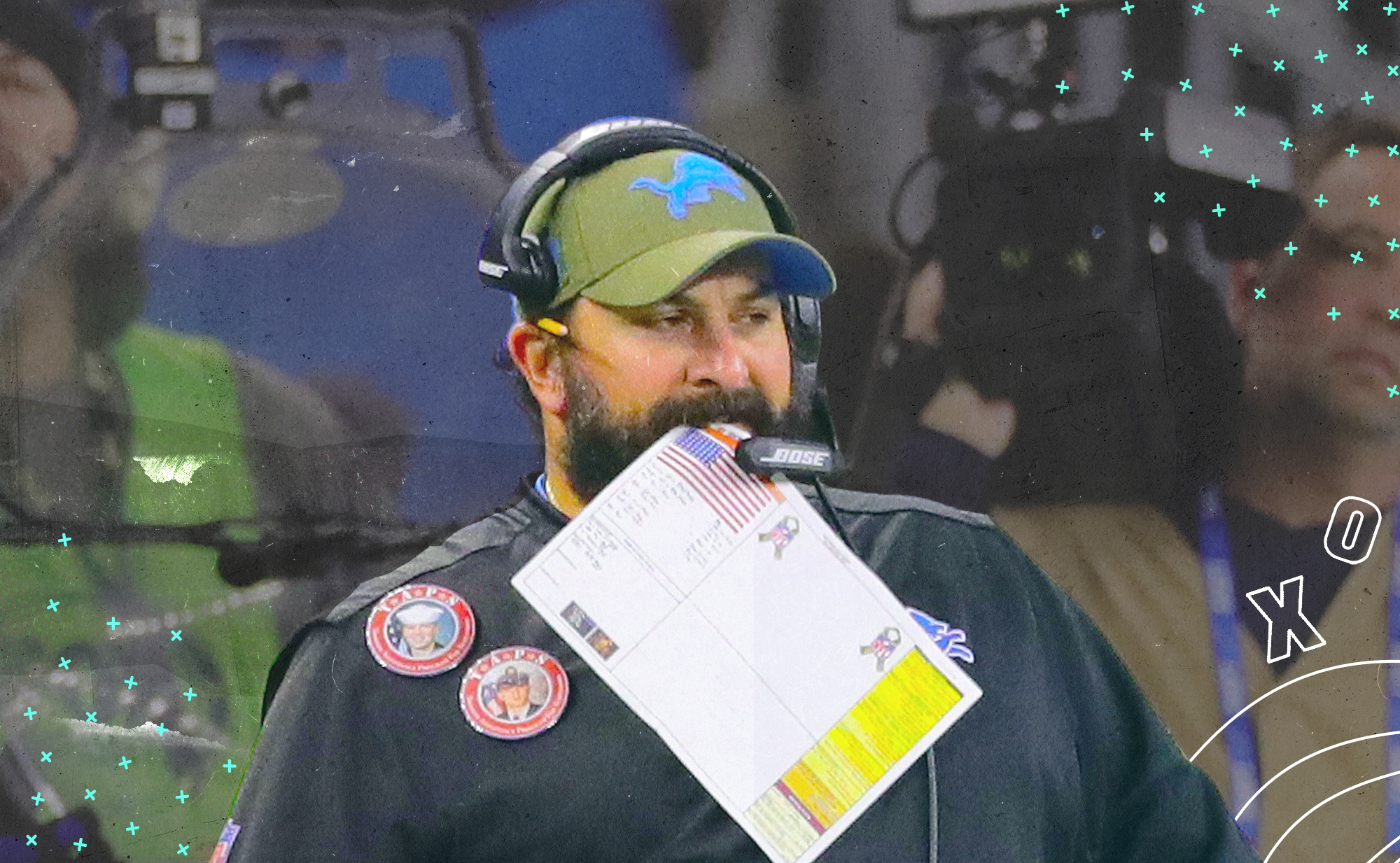 Lions coach Matt Patricia has a playsheet in his mouth, with white X's and O's and blue stars in the background