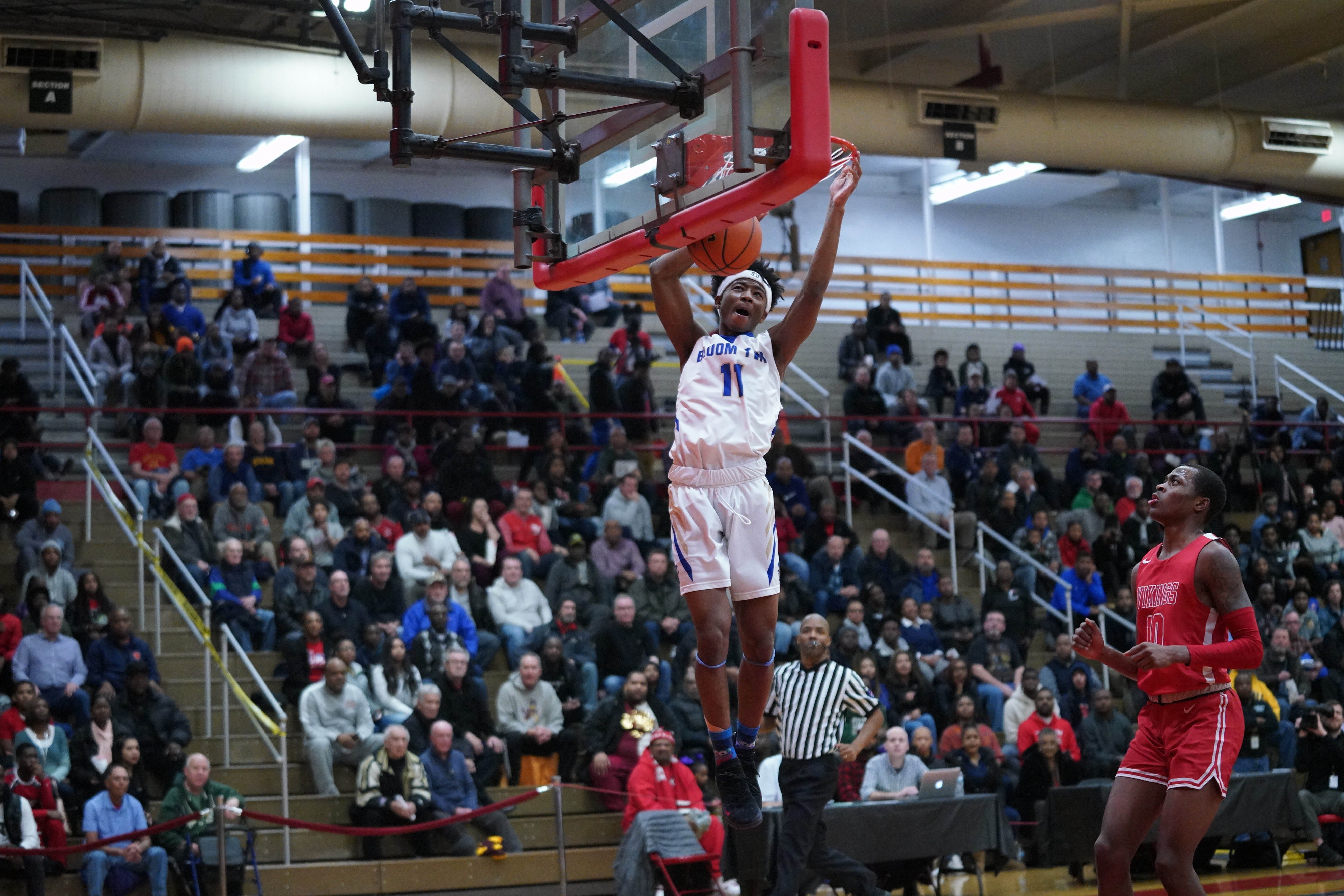 Bloom's Keshawn Williams (11) gets a steal and a dunk against Homewood-Flossmoor.