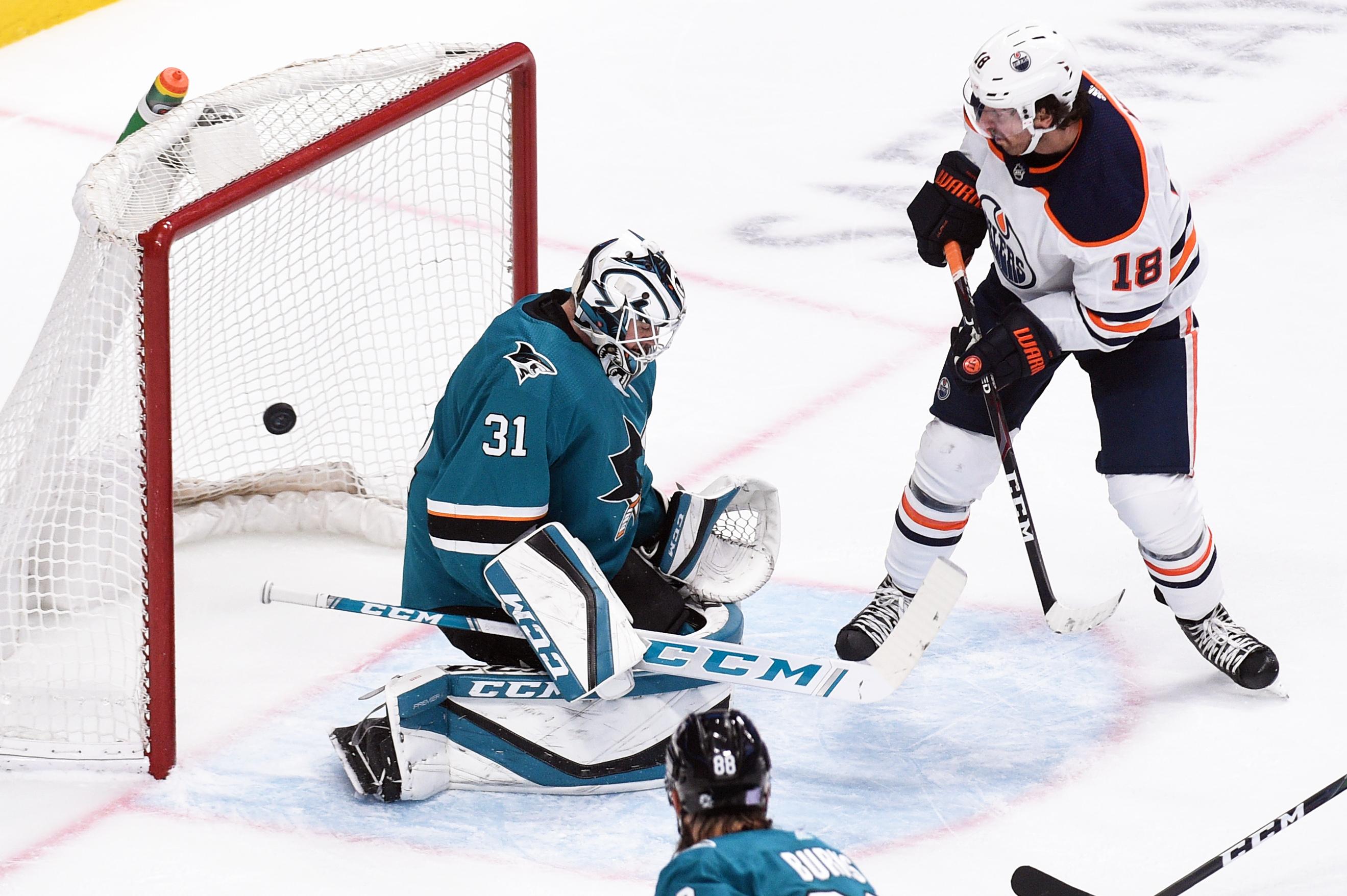 Nov 19, 2019; San Jose, CA, USA; Edmonton Oilers left wing James Neal (18) scores a goal past San Jose Sharks goalie Martin Jones (31) during the second period at SAP Center in San Jose.