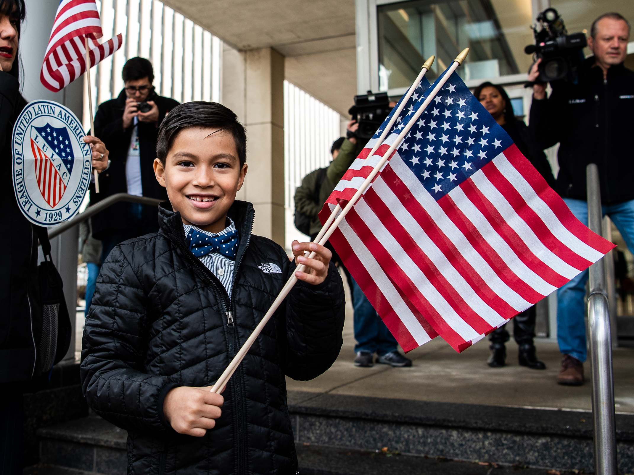 Iker Velasquez, an 8-year-old asylum seeker, waits outside the Chicago Immigration Court with family, teachers and activists before a hearing for his asylum trial, Wednesday, Nov. 20, 2019.