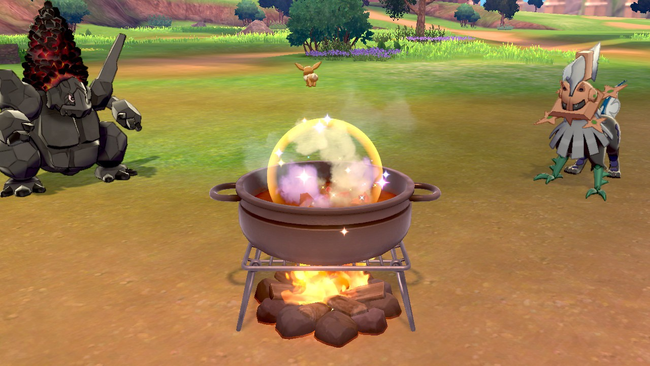 Two Pokémon stare at a curry pot in Pokémon Sword and Shield