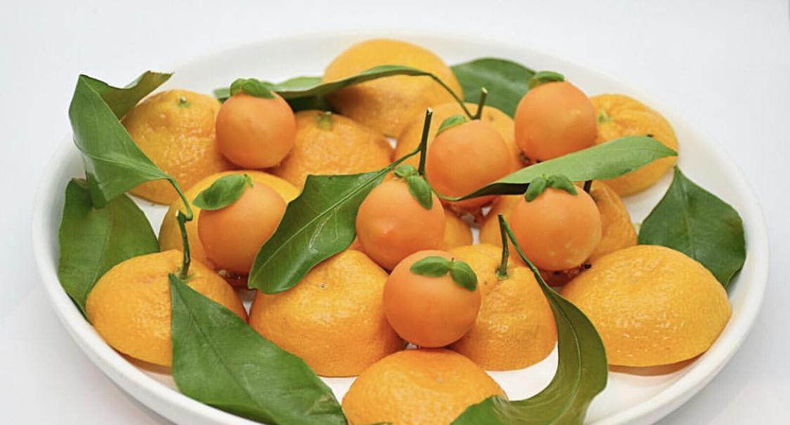 A platter of real and edible Satsuma oranges at Georgia Boy in Atlanta, GA
