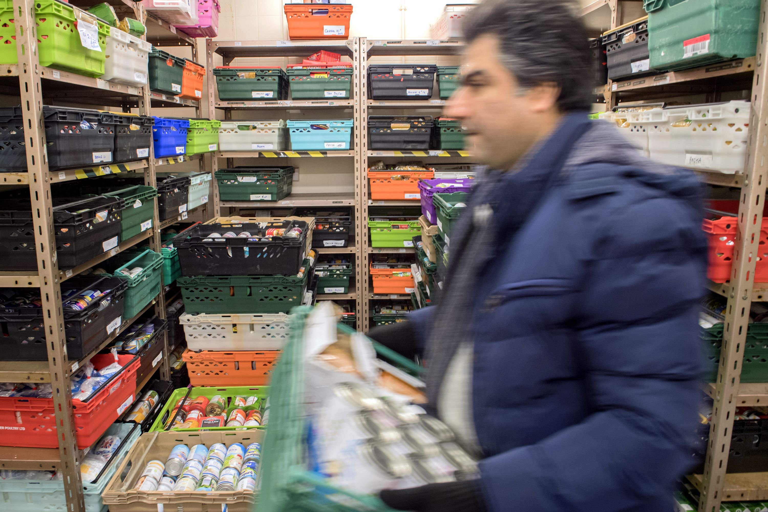 A U.K. food bank moves food donations for distribution