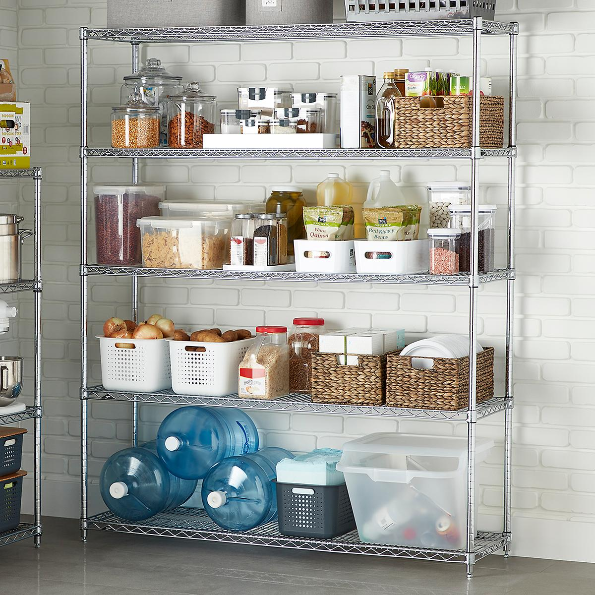 A metal shelving unit pictured in a tiled room or closet, with multiple shelves neatly stacked with canisters and bins of food items