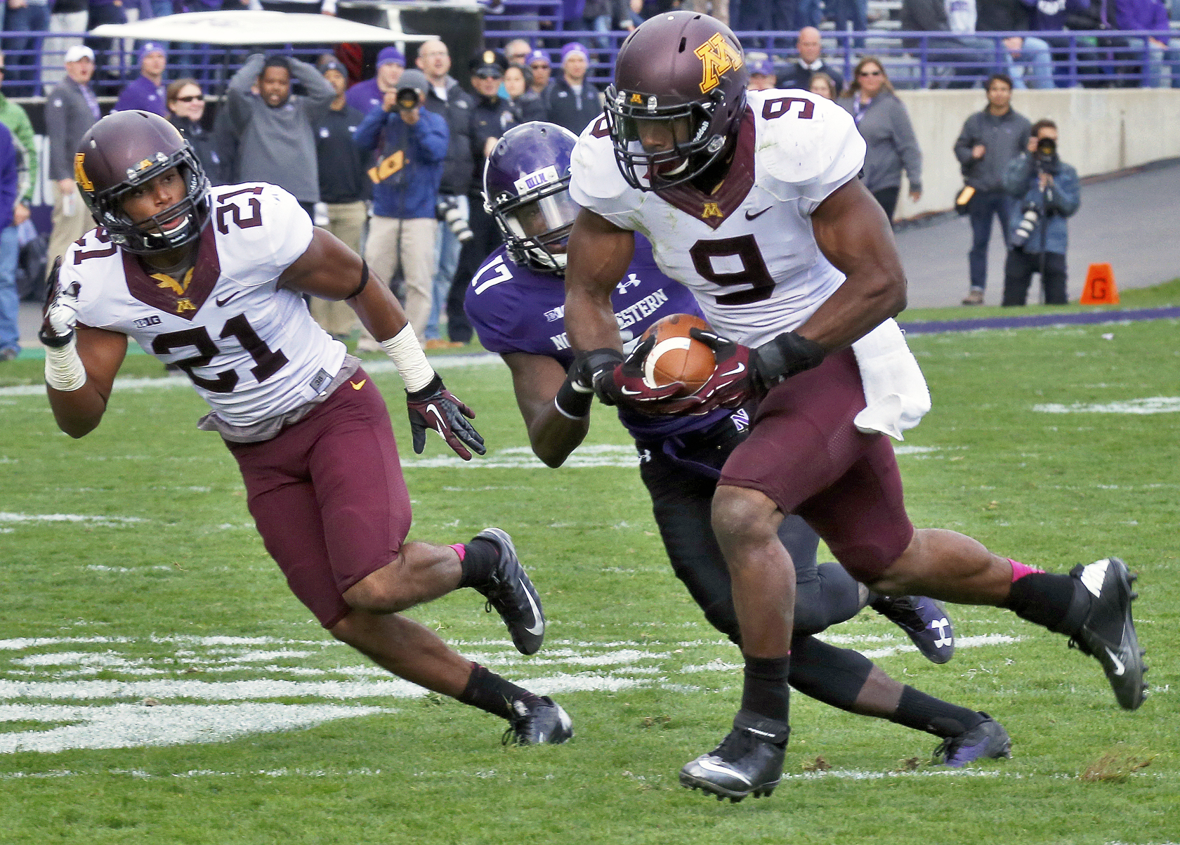 Minnesota Gophers vs. Northwestern Wildcats football. Minnesota won 20-17. Minnesota linebacker James Manuel (9) headed for the end zone and a touchdown after intercepting a Northwestern pass in 2nd half action putting the Gophers ahead to stay 14-7. . (