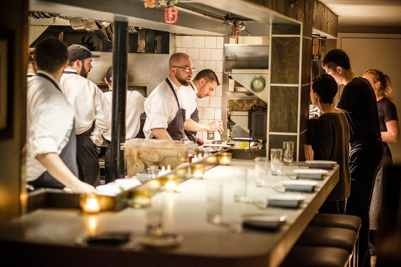 chefs in a restaurant kitchen