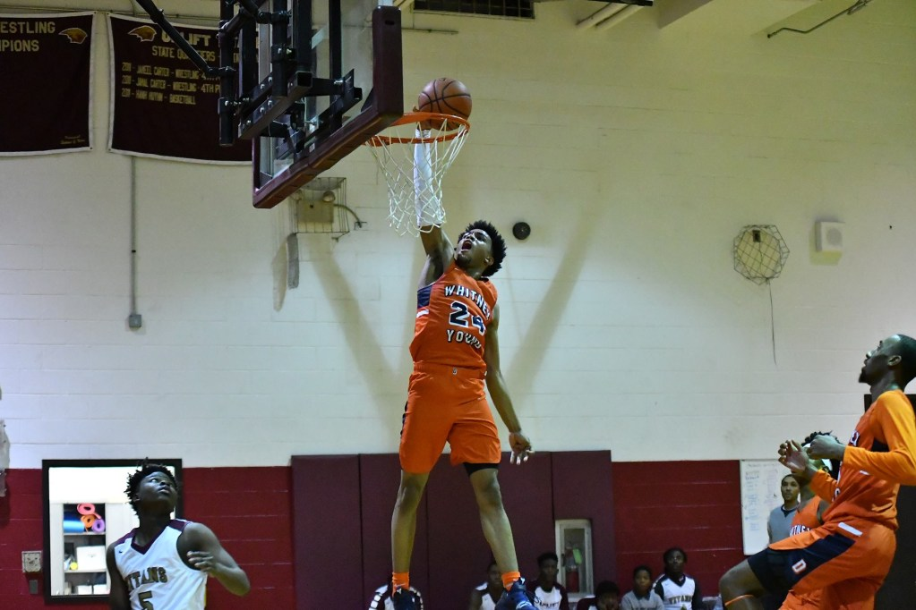 Young's Tyler Beard (24) attempts a dunk against Uplift.