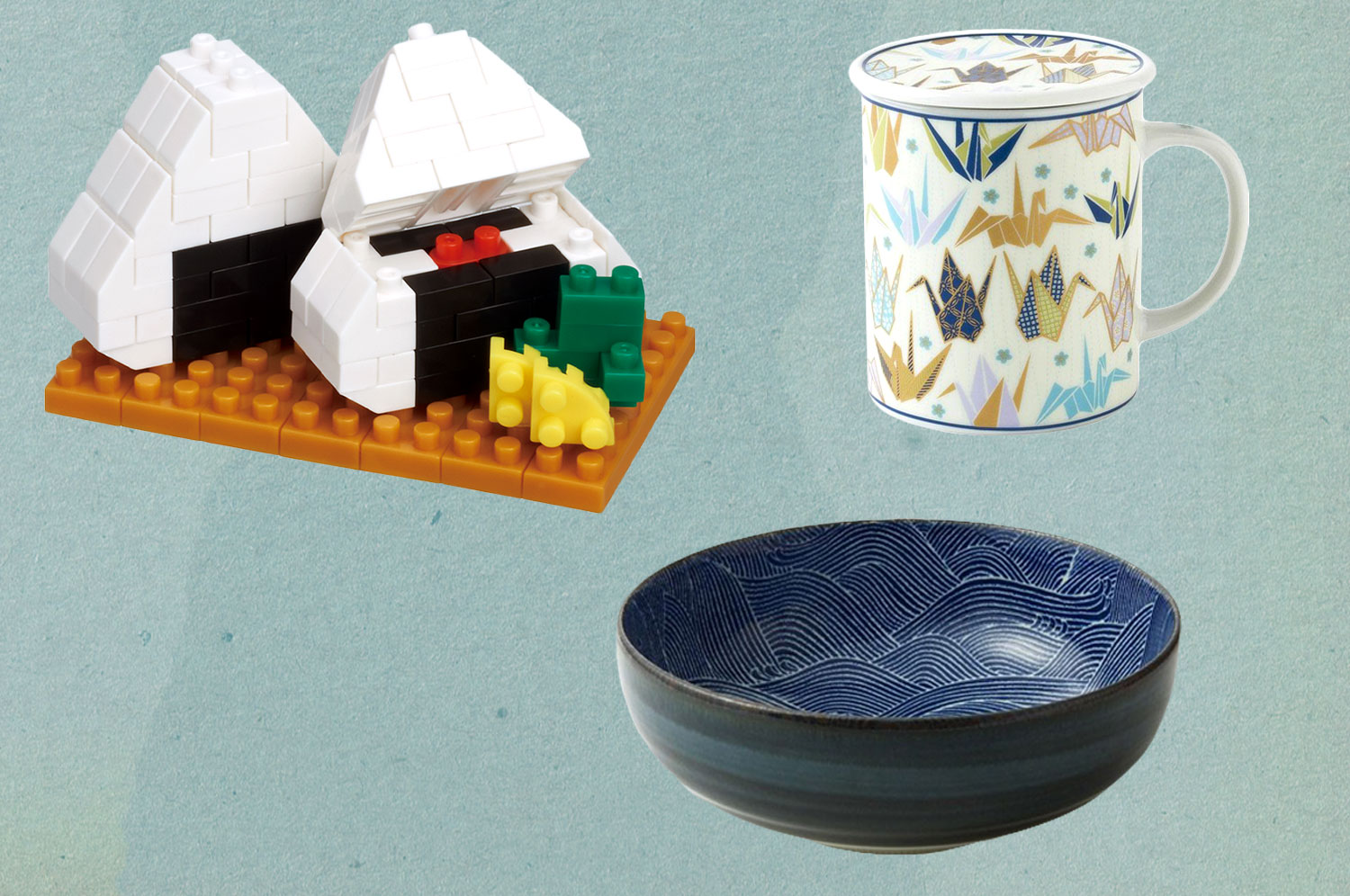 Nanoblocks in the shape of onigiri, a ceramic mug printed with paper cranes, and a blue Japanese serving bowl.