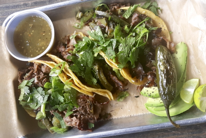 Oak-smoked bistec tacos, with nopales, cilantro, onion, and salsa verde from Micklethwait