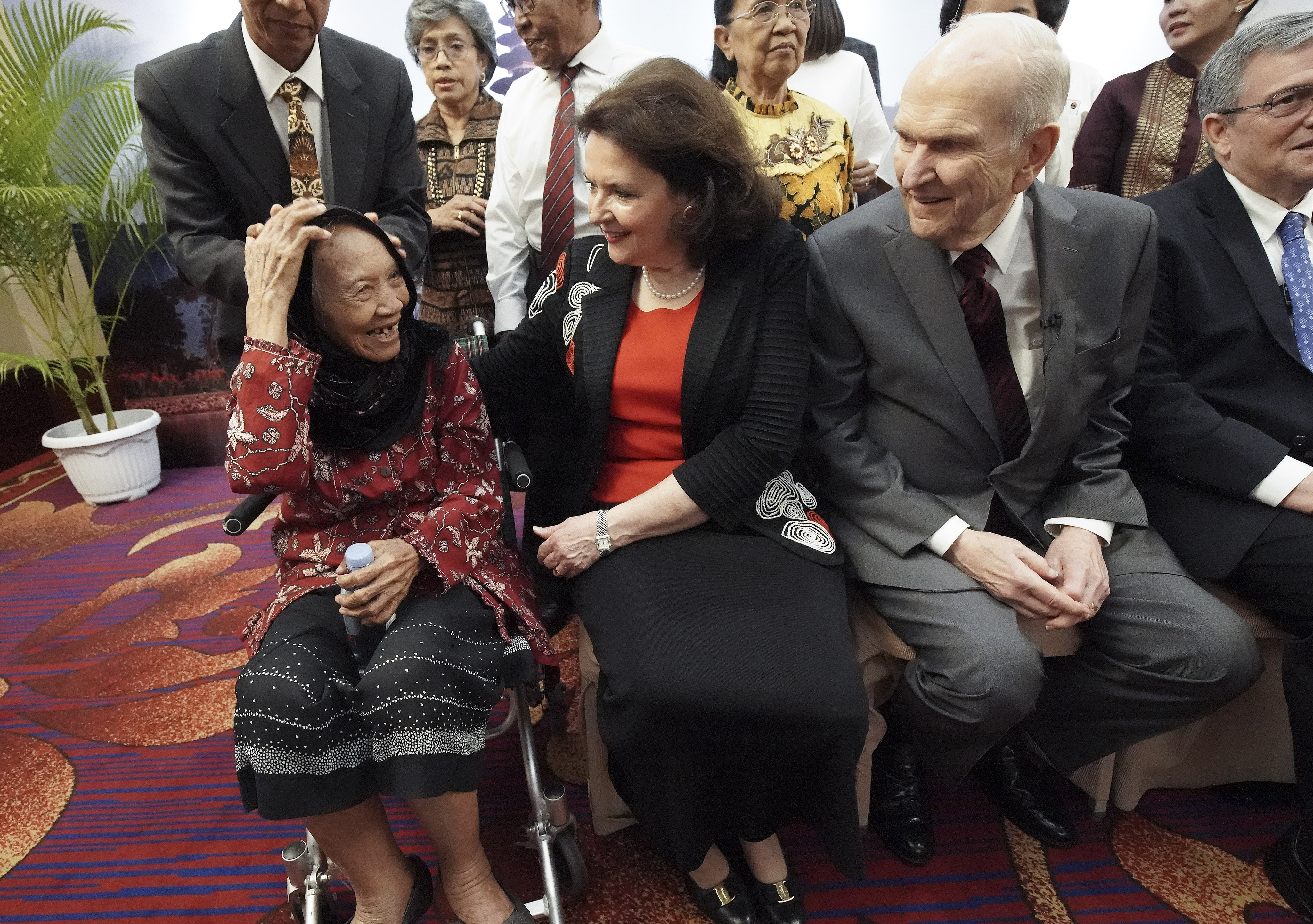 President Russell M. Nelson of The Church of Jesus Christ of Latter-day Saints and his wife, Sister Wendy Nelson, talk with 86-year-old Tumini as he meets with multigenerational families in Jakarta, Indonesia, on Nov. 21, 2019.