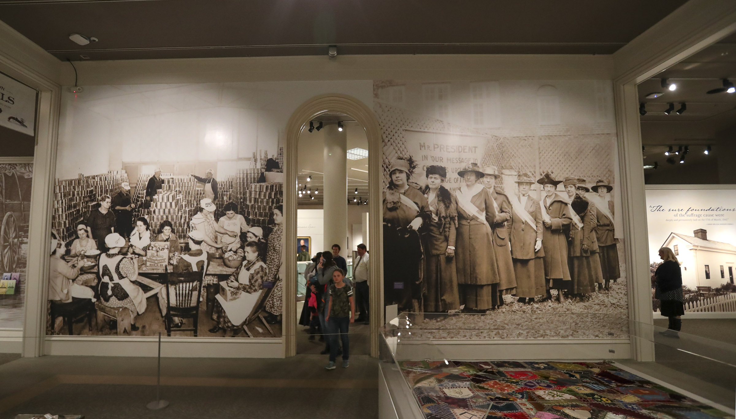 """Large photographs mark the entrance to the Church History Museum's new exhibit """"Sisters for Suffrage: How Utah Women Won the Vote"""" in Salt Lake City on Thursday, Nov. 21, 2019."""