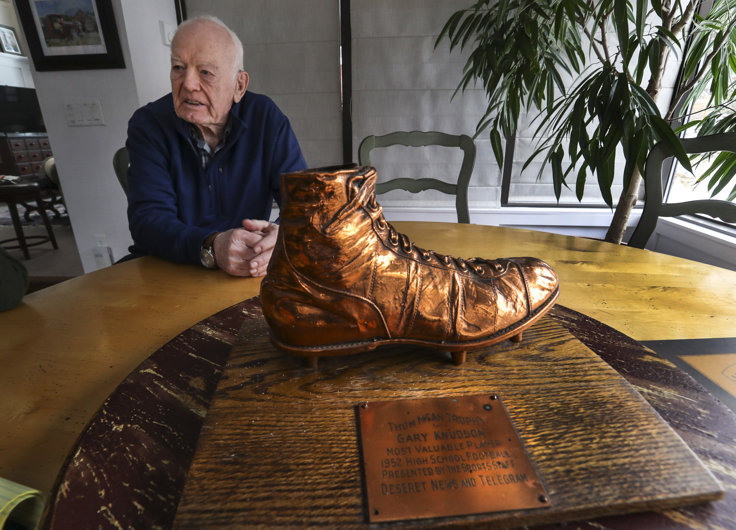 Gary Knudsen, who coached the Park City High School football team from 1962 to 1965, talks about his coaching memories from his home in Park City on Wednesday, Nov. 20, 2019. Knudsen's high school bronzed football shoe from 1952 is part of the player of the year trophy he won playing for West High School in Salt Lake City.