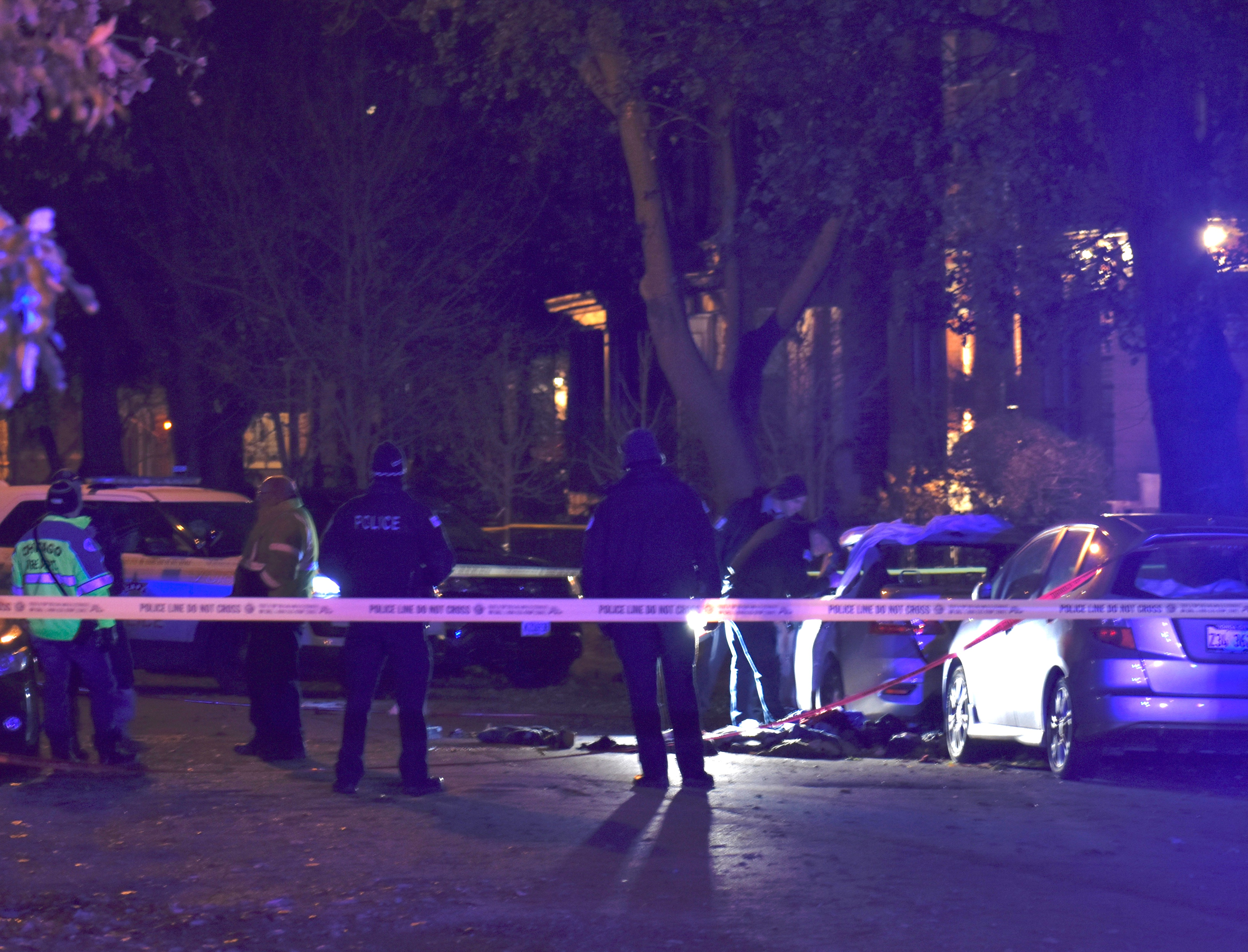 Police investigate after a woman was found dead in a burning car Nov. 22, 2019, in the 1400 block of West Farragut Avenue.
