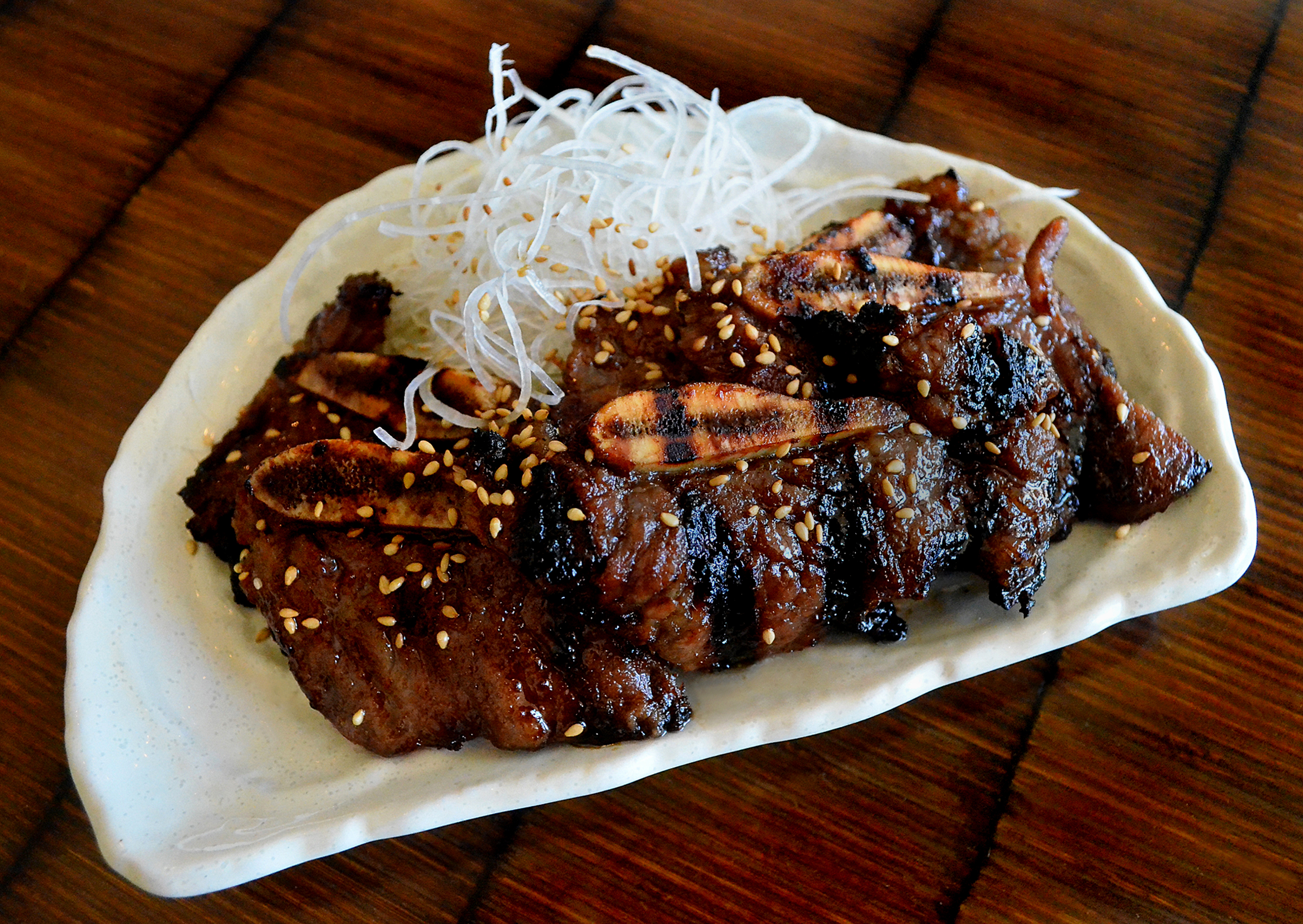 Grilled Korean-style short ribs on a plate.